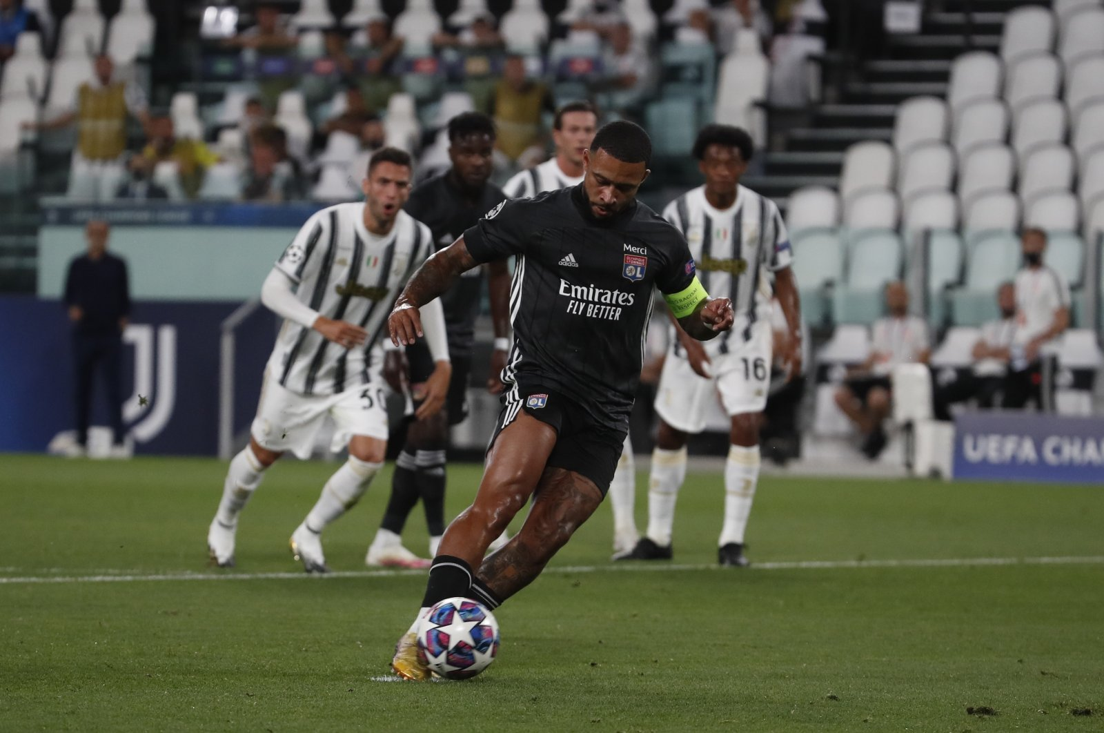 Lyon's Memphis Depay scores a penalty during the Champions League match against Juventus in Turin, Italy, Aug. 7, 2020. (AP Photo)