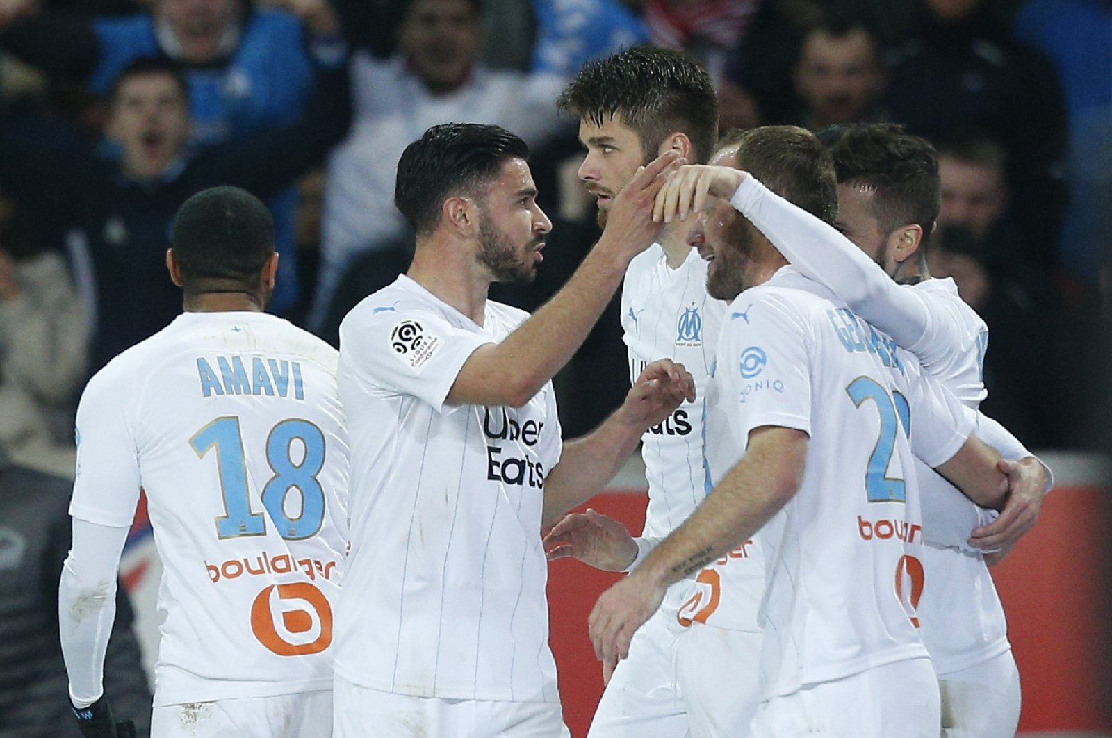 Marseille players celebrate a goal during a Ligue 1 match against Lille in Villeneuve d'Ascq, northern France, Feb. 16, 2020. (AP Photo)