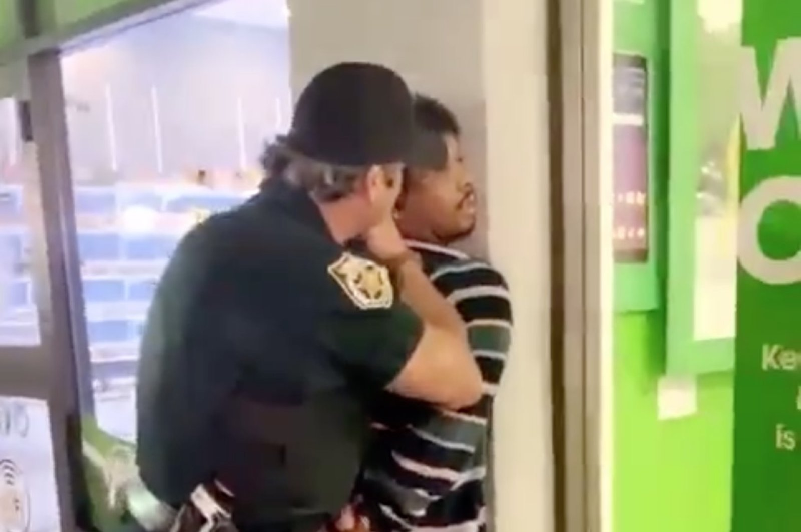 This screengrab from the video shared on Twitter shows sheriff deputy Charles Rhoads shoving the black man he detained in Florida's Palm Beach County on Aug. 18, 2020.
