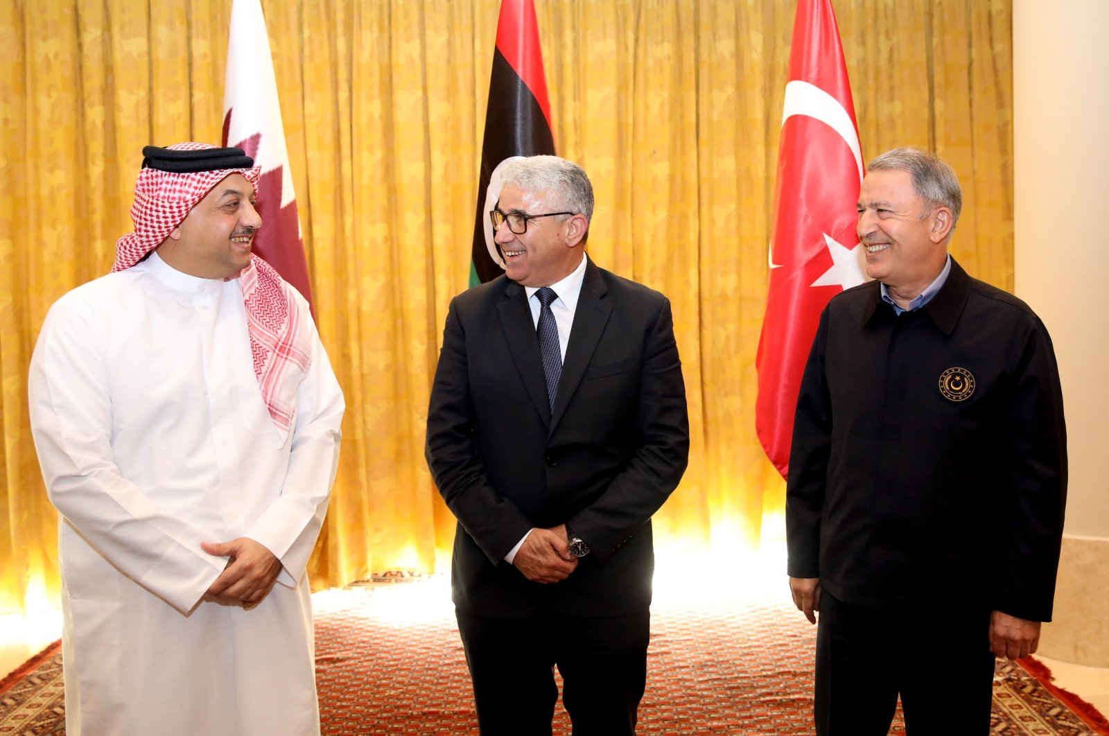 Interior Minister of Libya's UN-recognised Government of National Accord (GNA) Fathi Bashagha (C) meets with Turkish Defense Minister Hulusi Akar (R), and his Qatari conterpart Khalid bin Muhammad Al-Attiyah (L) in the capital Tripoli, Aug. 17, 2020.