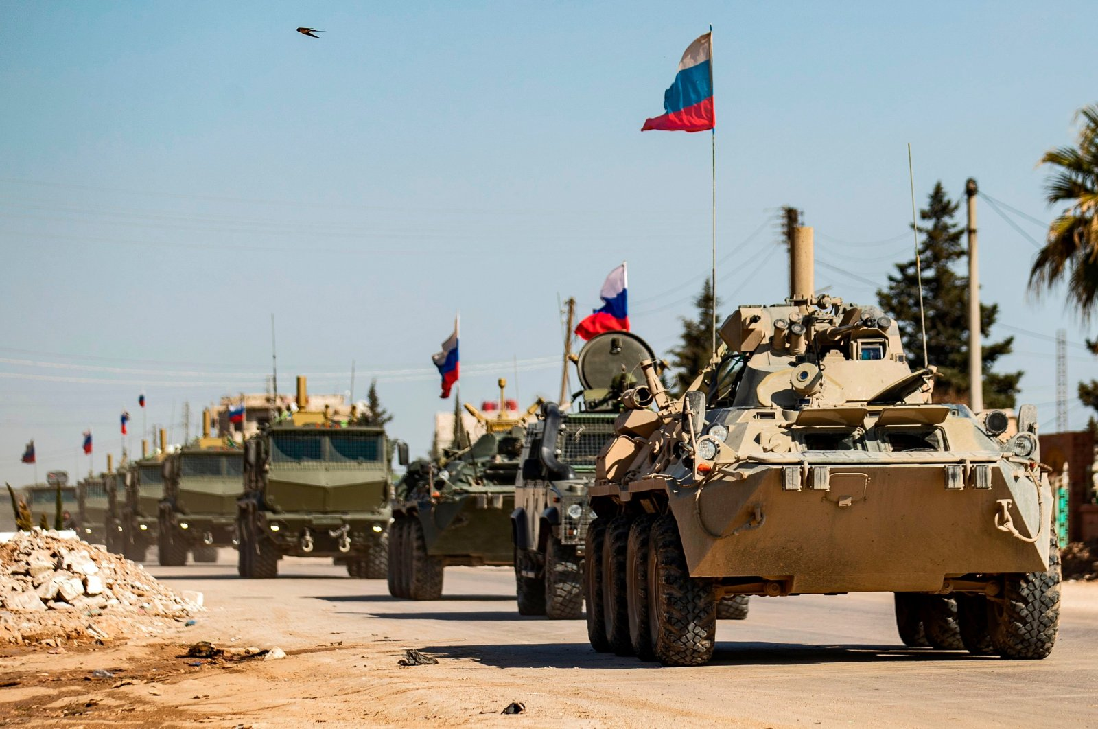 Russian military vehicles driving in a convoy from the town of Tal Tamr to Qamishli airport, in the city of Qamishli in Syria's northeastern Hassakeh province, March 9, 2020. (AFP)
