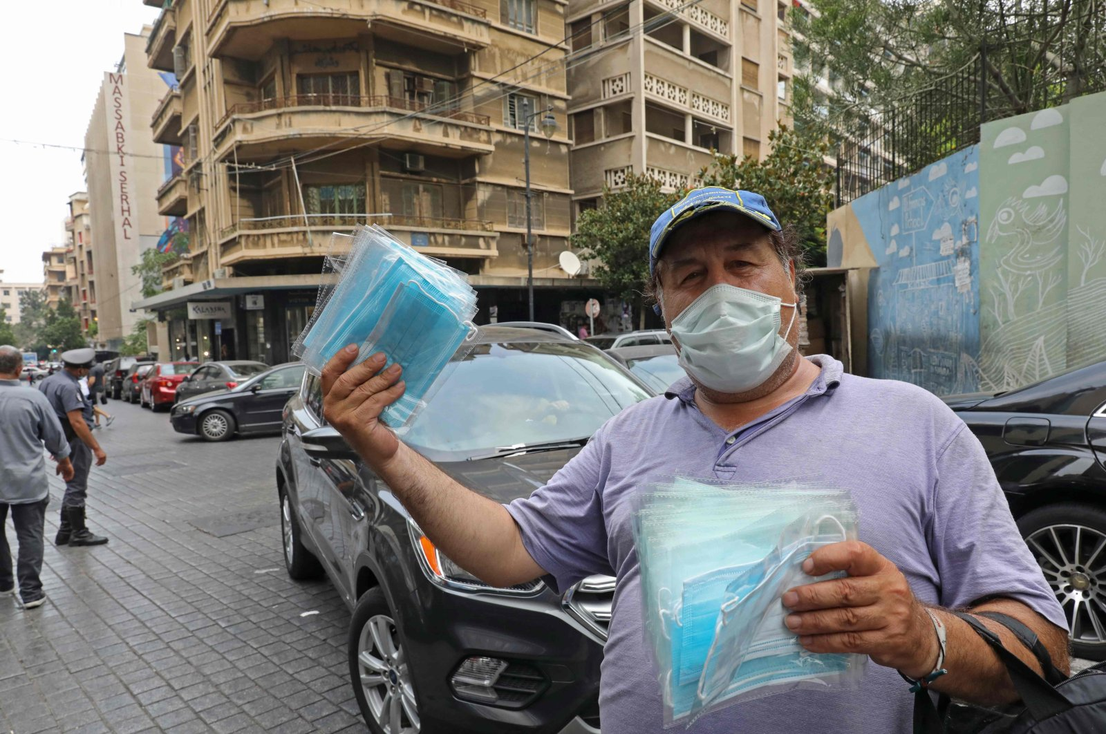 A man sells protective face masks ahead of lockdown measures after a spike in new cases threatened to overwhelm the crisis-hit Lebanon's health care system, Beirut, Lebanon, July 29, 2020. (AFP Photo)