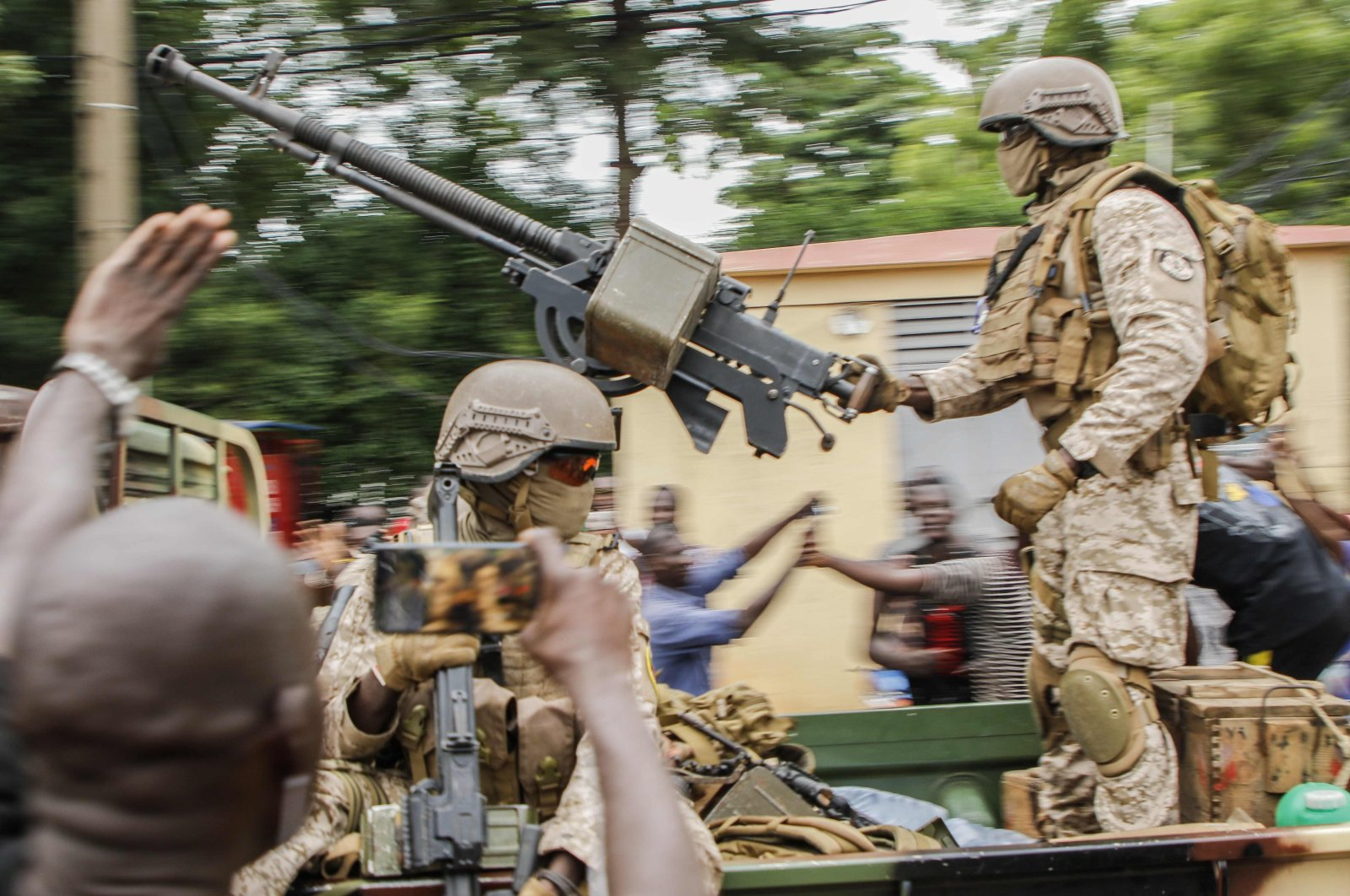 Malian soldiers parade as they arrive by military vehicle at Independence Square in Bamako, Mali, after rebel troops seized Malian President Ibrahim Boubacar Keita and Prime Minister Boubou Cisse in a dramatic escalation of a monthslong crisis, Aug. 18, 2020. (AFP Photo)