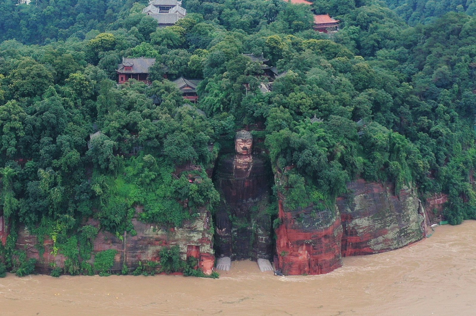 Floodwater reaches the Leshan Giant Buddha's feet following heavy rainfall, in Leshan, Sichuan province, China, Aug. 18, 2020. (China Daily via Reuters)