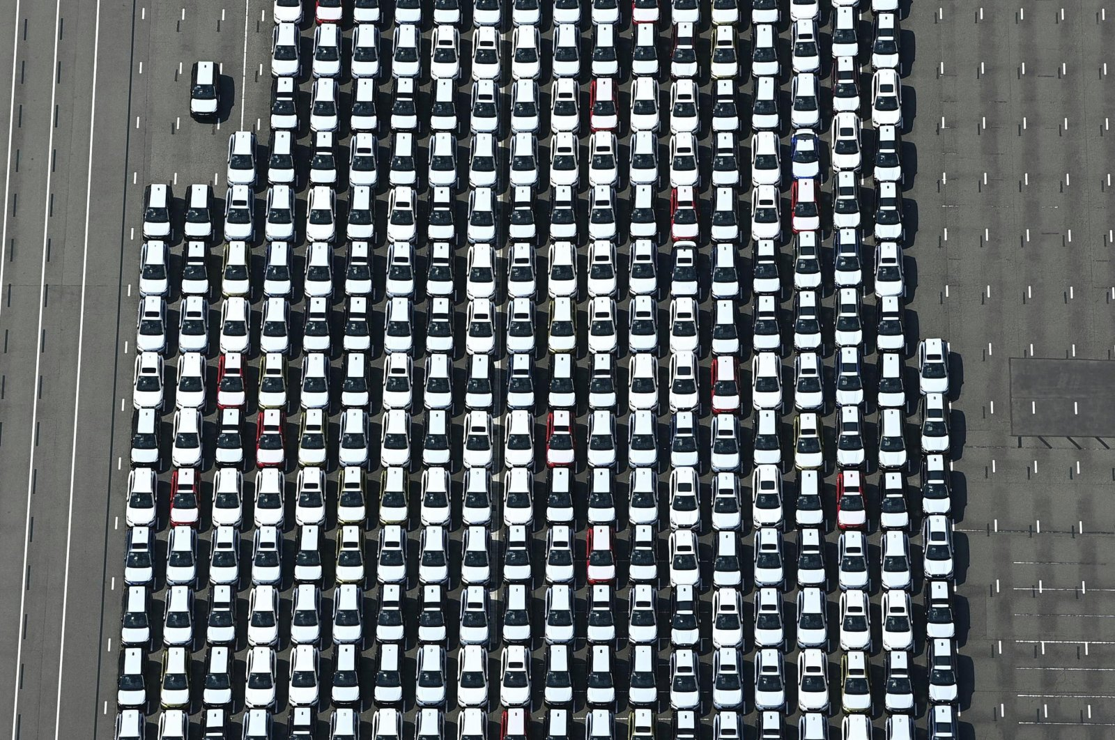 Vehicles are parked before being exported, at a logistics center in Kawasaki, near Tokyo, Japan, Aug. 17, 2020. (AP Photo)