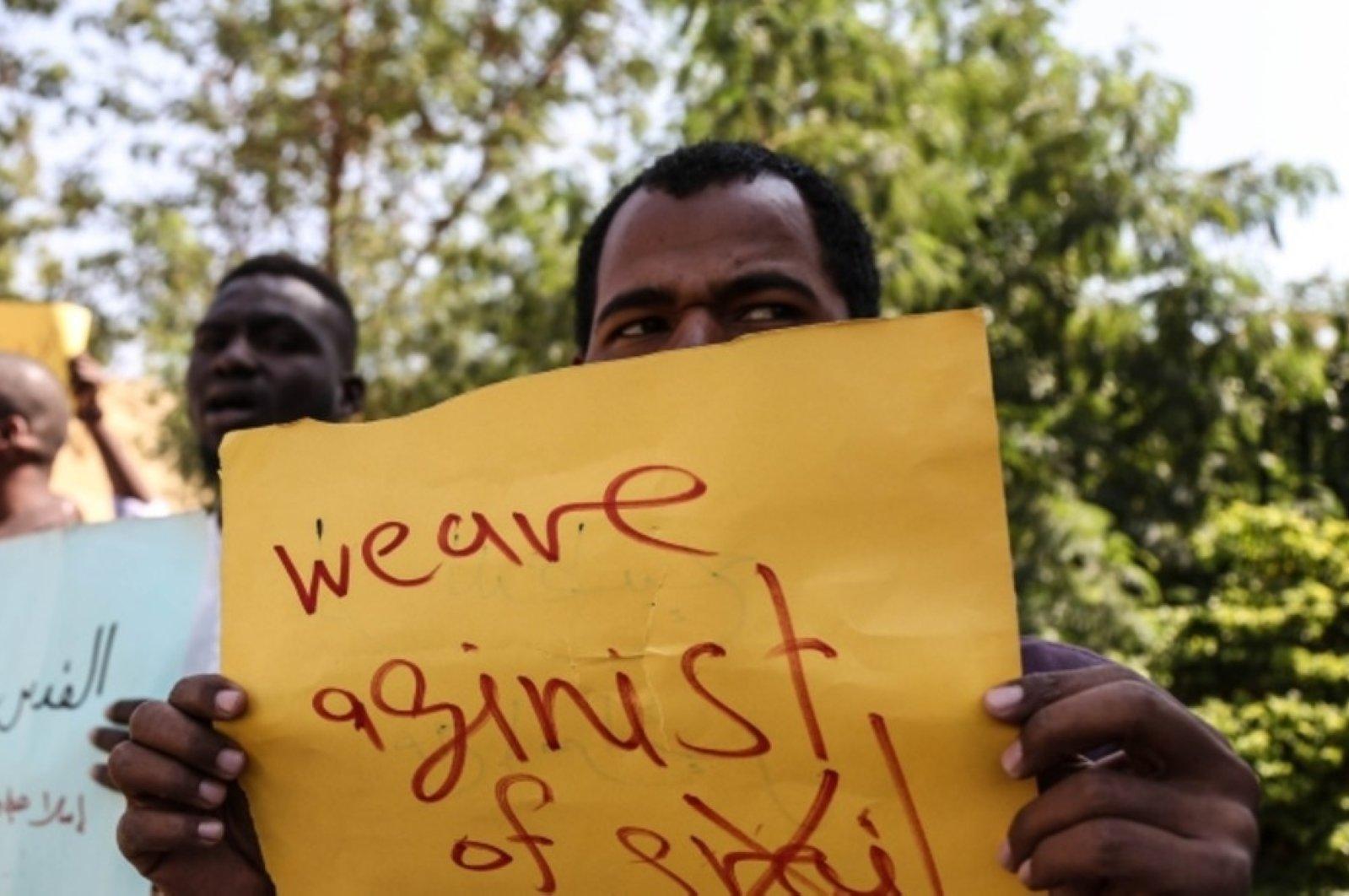 Protesters react to Sovereign Council chief Abdel Fattah al-Burhan's meeting with Israeli Prime Minister Benjamin Netanyahu, Khartoum, Sudan, Feb. 4, 2020. (AA Photo)