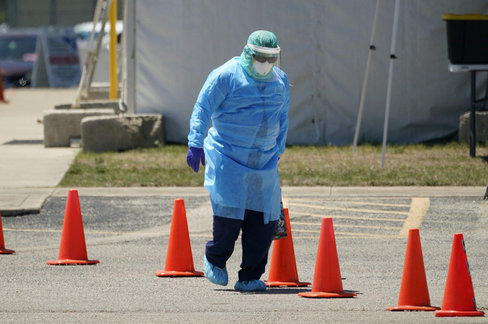 Medical personnel prepare a drive-thru COVID-19 testing site, San Antonio, Texas, Aug. 14, 2020. (AP Photo)
