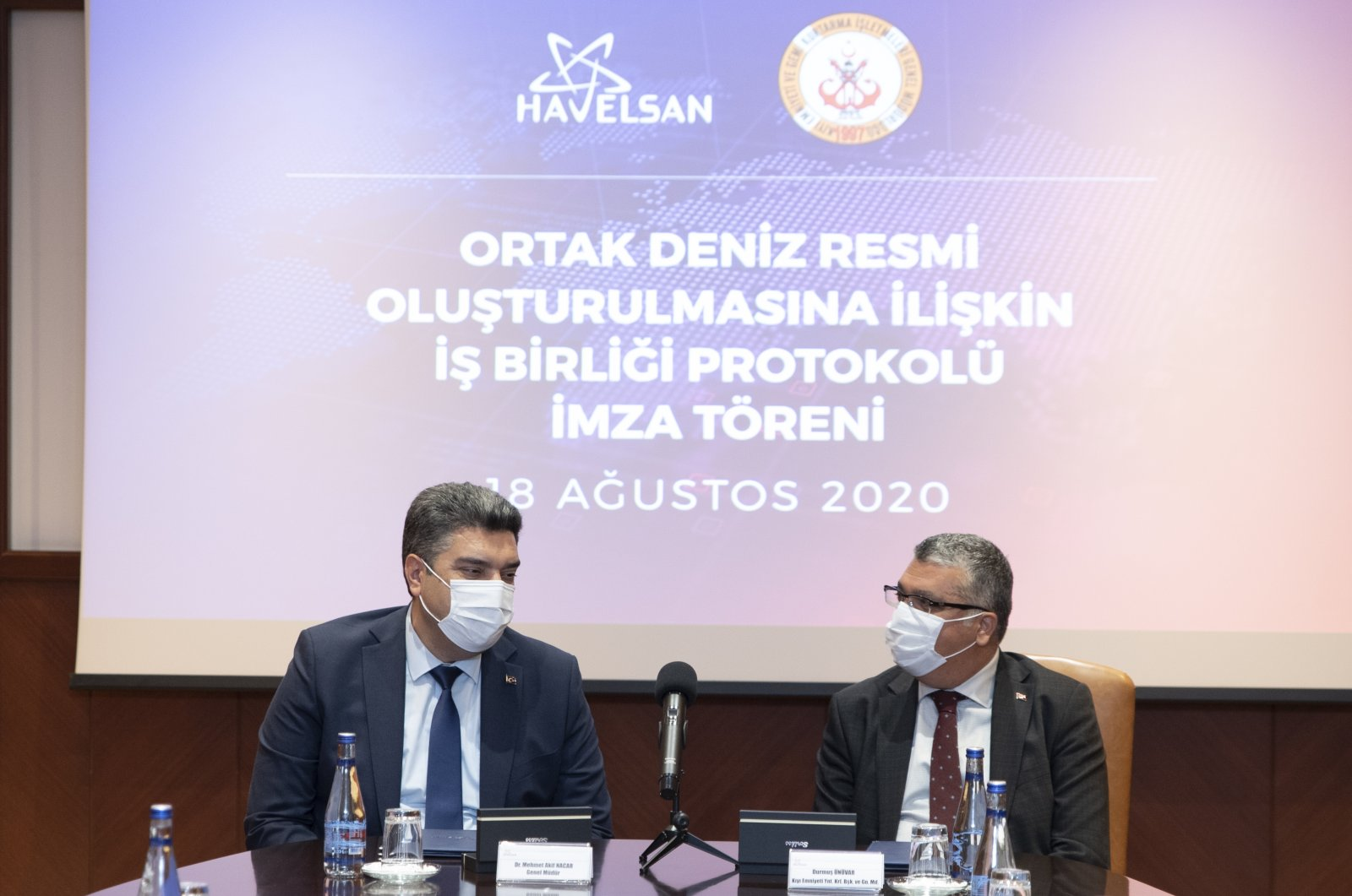 HAVELSAN chairman Mehmet Akif Nacar (L) and Directorate General of Coastal Safety General Manager Durmuş Ünüvar sit together at the signing of the cooperation protocol, Aug. 18, 2020. (AA Photo)