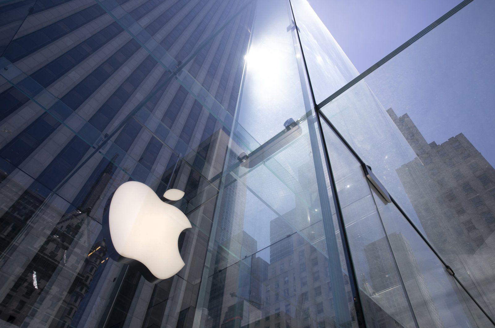 The sun is reflected on Apple's Fifth Avenue store in New York City, New York on June 16, 2020. (AP Photo)