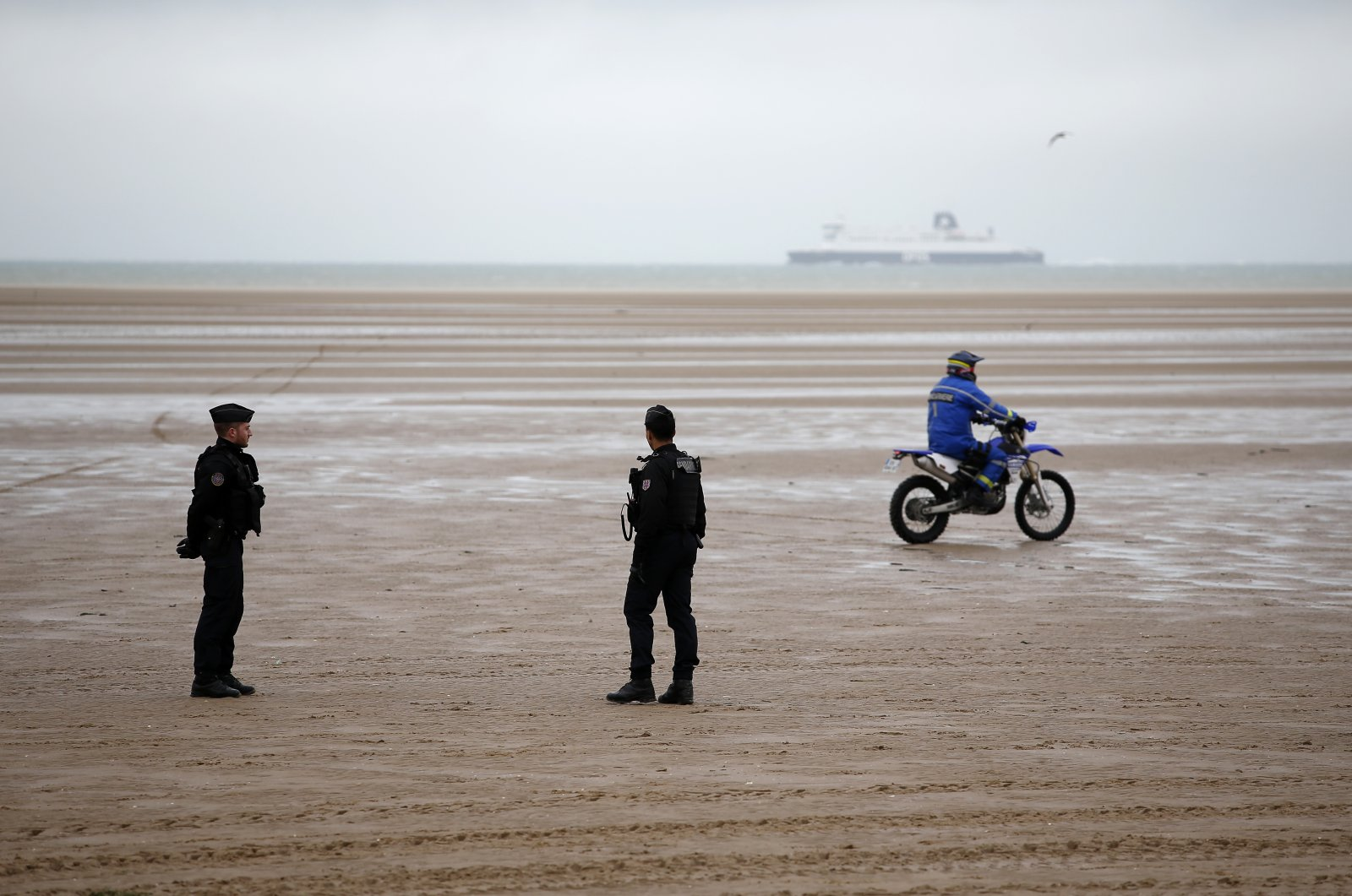 Police officers patrol on the beach of Oye-Plage, northern France, near Calais on Jan. 31, 2020. (AP Photo/Michel Spingler, File)