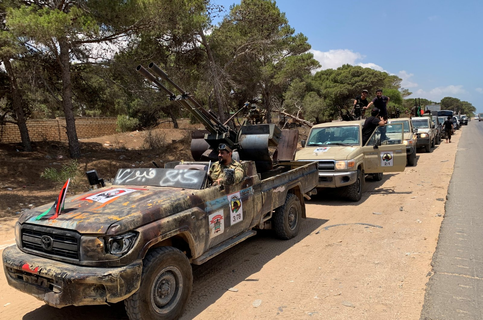 Troops loyal to Libya's internationally recognized government are seen in military vehicles as they prepare before heading to Sirte, in Tripoli, July 6, 2020. (Reuters Photo)