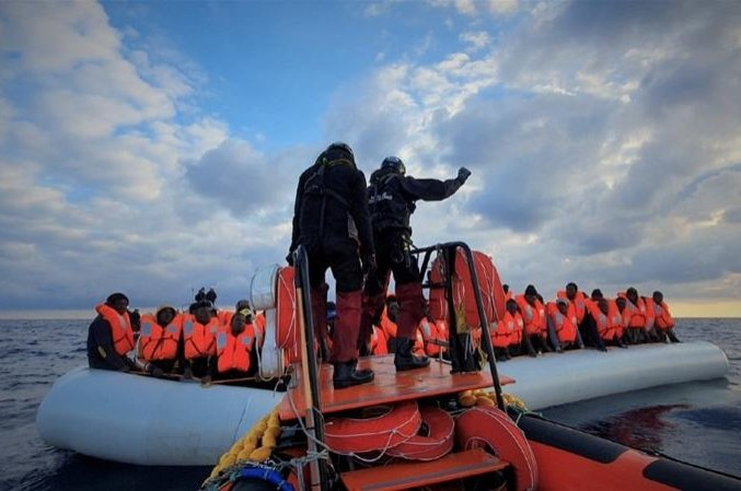 Migrants wearing life jackets on a rubber dinghy are pictured during a rescue operation, off the coast of Libya. (Reuters Photo)