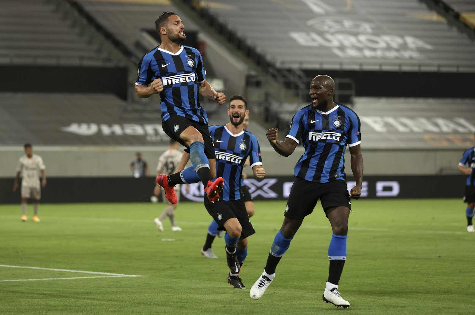 Inter Milan players celebrate a goal during the Europa League semifinal match against Shakhtar Donetsk in Dusseldorf, Germany, Aug. 17, 2020. (AP Photo)