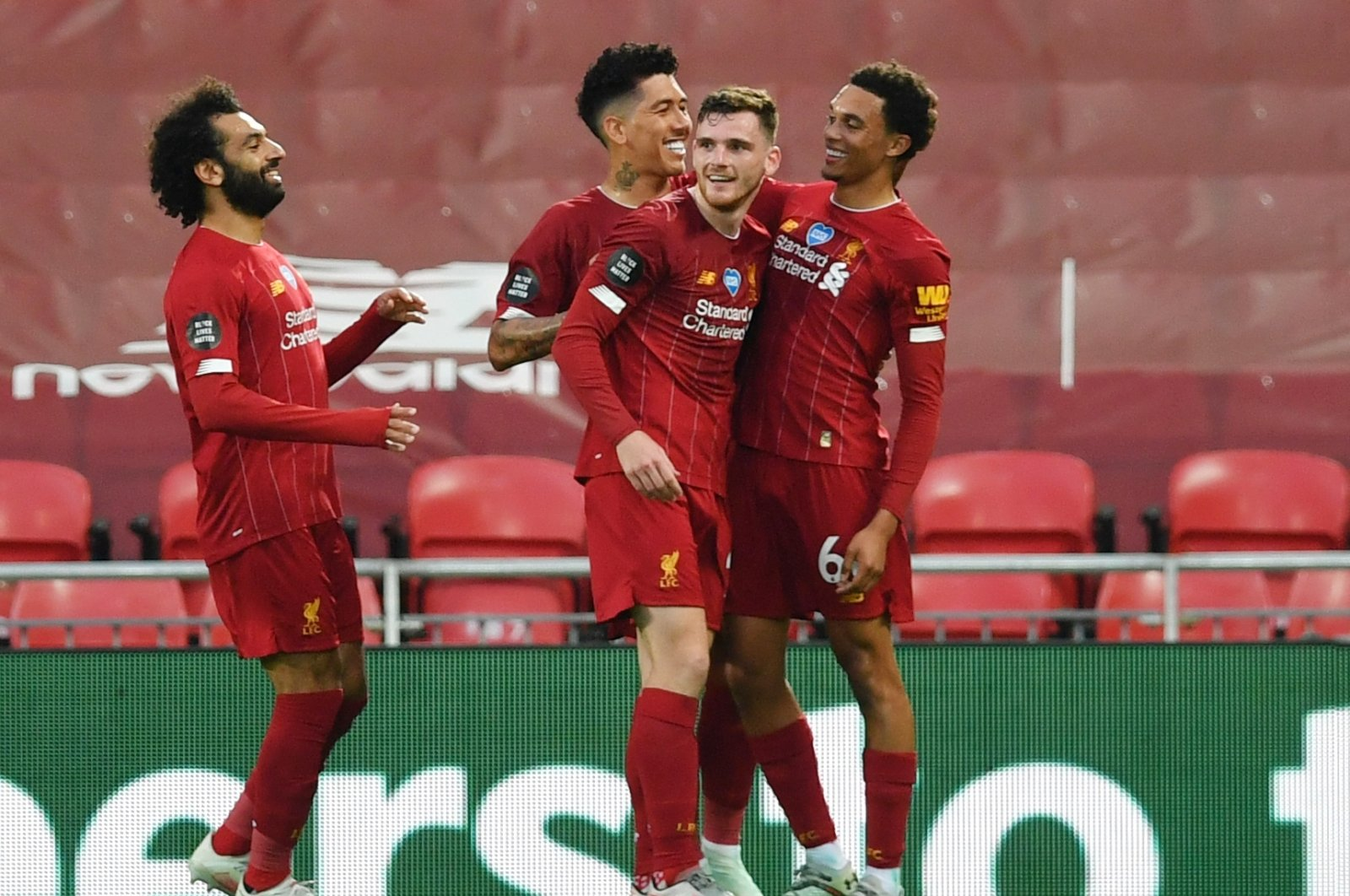 Liverpool players celebrate a goal during a Premier League match against Chelsea, in Liverpool, Britain, July 22, 2020. (Reuters Photo)