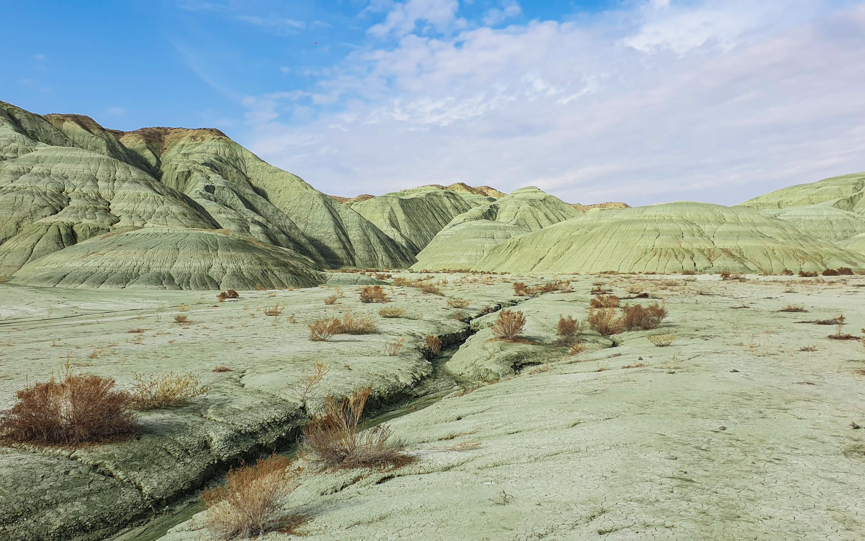 With not a single grass in sight, the green hills of the valley are reminiscent of deserts.