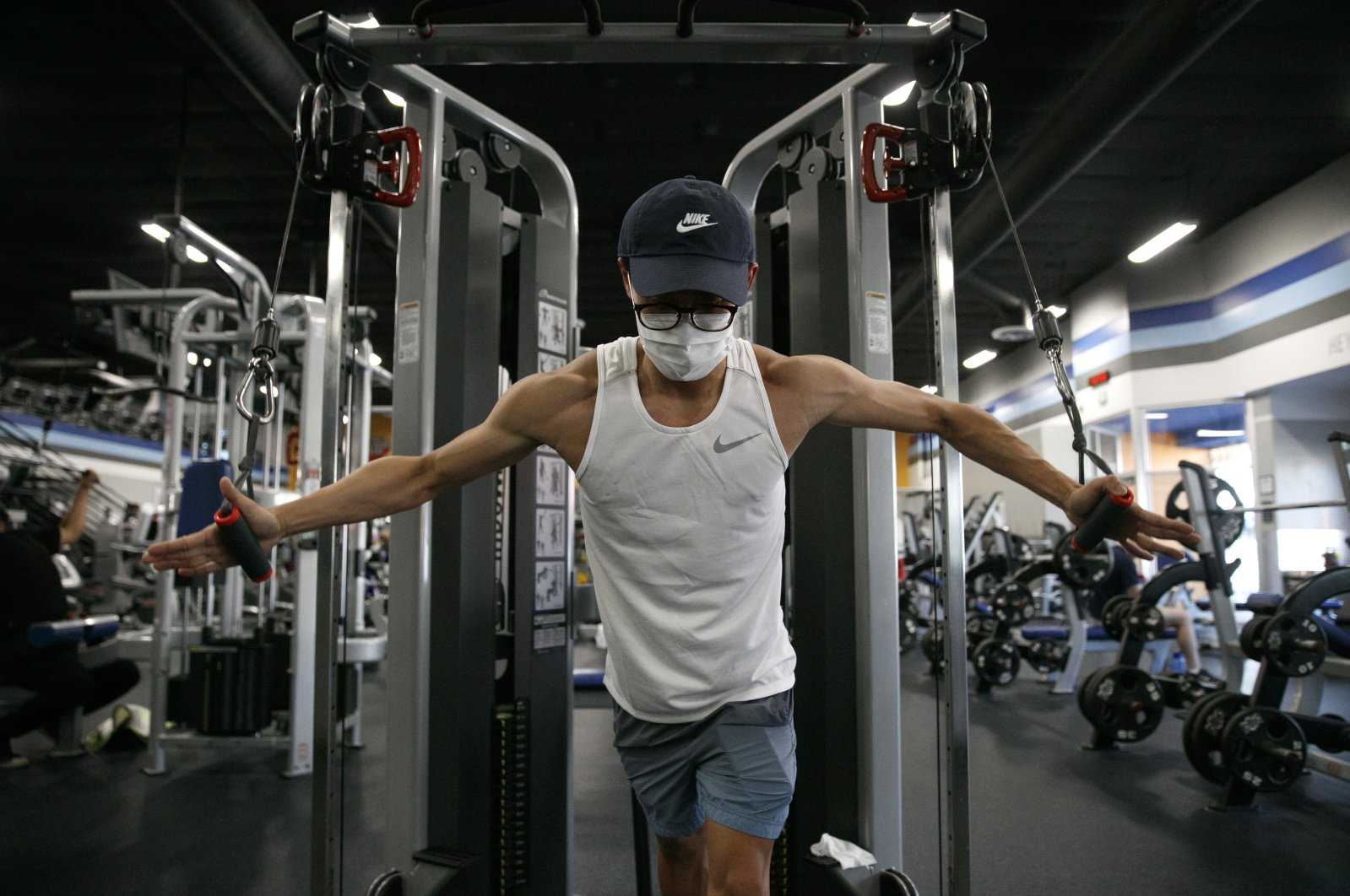 Benji Xiang, 32, wears a mask while working out at a gym in Los Angeles, California, U.S., June 26, 2020. (AP Photo)