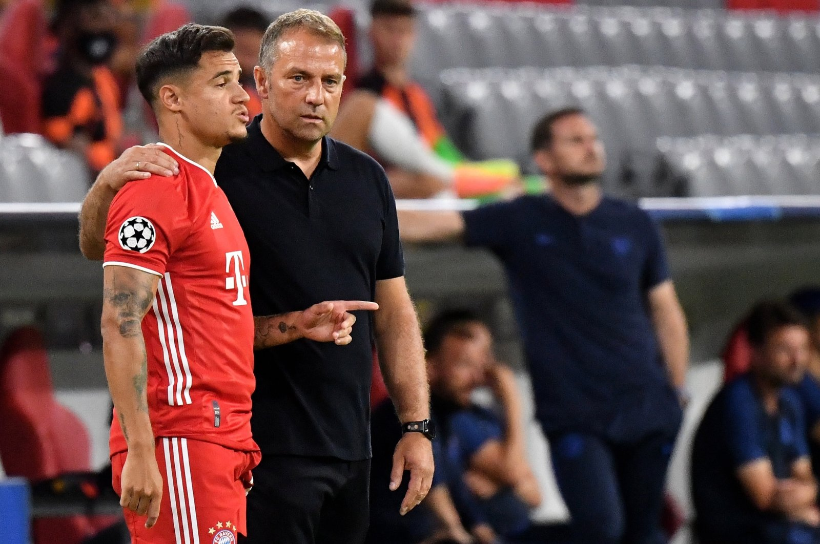Bayern Munich coach Hansi Flick (R) gives directions to Philippe Coutinho during a UEFA Champions League Round match against Chelsea in Munich, Germany, Aug. 8, 2020.  (EPA Photo)