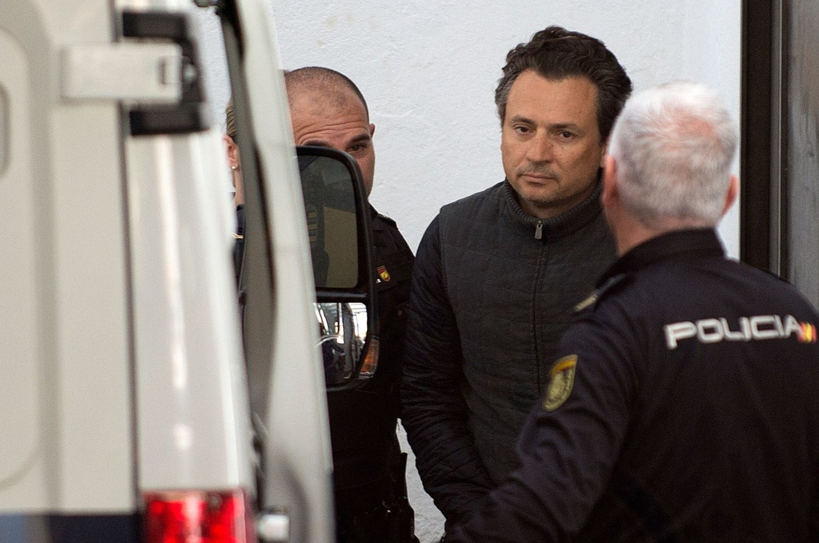 In this file photo taken on Feb. 13, 2020, Emilio Lozoya, former chief executive (2012-2018) of Mexico's state oil company PEMEX, is transferred to a police van in Marbella, Spain. (AFP Photo)