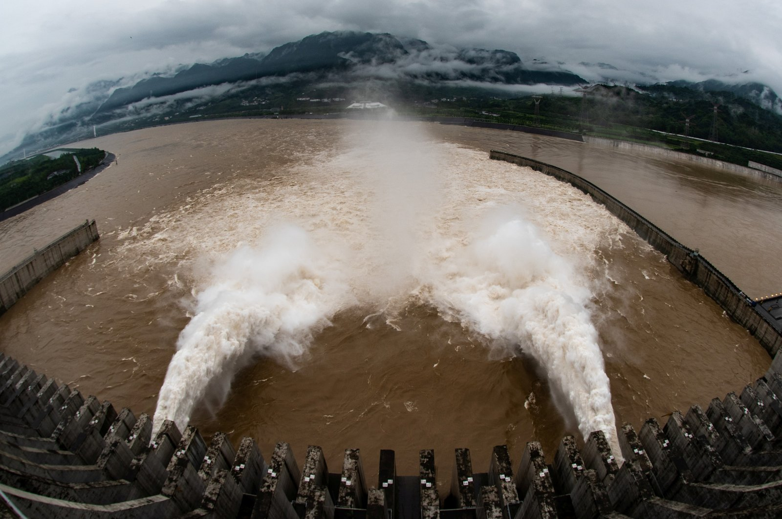The Three Gorges Dam on the Yangtze River discharges water to lower the water level in the reservoir following heavy rainfall and floods in a few regions, in Yichang, Hubei province, China, July 17, 2020. (China Daily via Reuters)