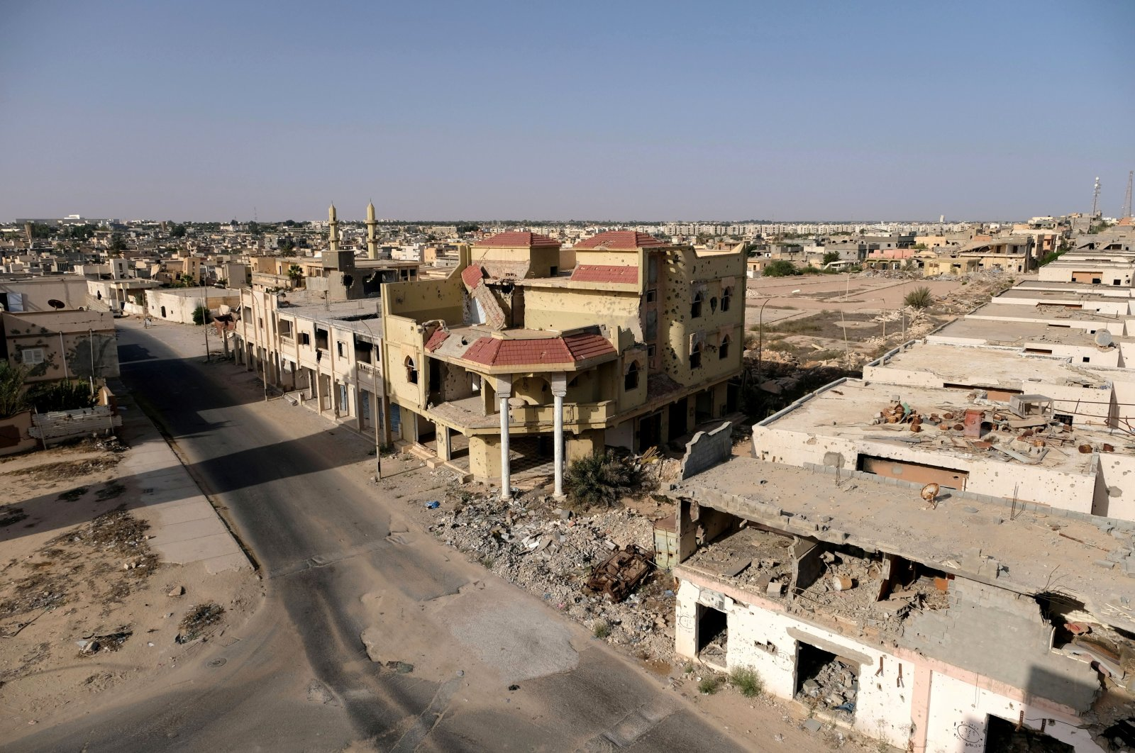 Buildings destroyed during past clashes remain part of the scenery in Sirte, Libya, Aug. 18, 2020. (REUTERS Photo)
