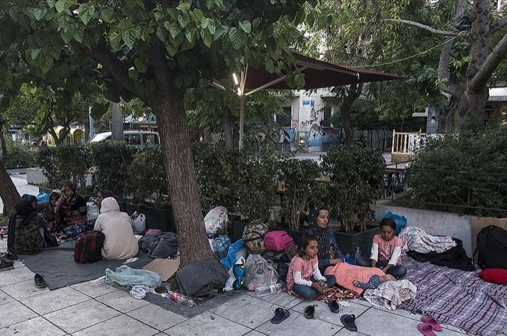 An Afghan family spends the night outside after being expelled from Greece's Moria camp and having nowhere else to go, Athens, Greece, June 15, 2020. (AA Photo)