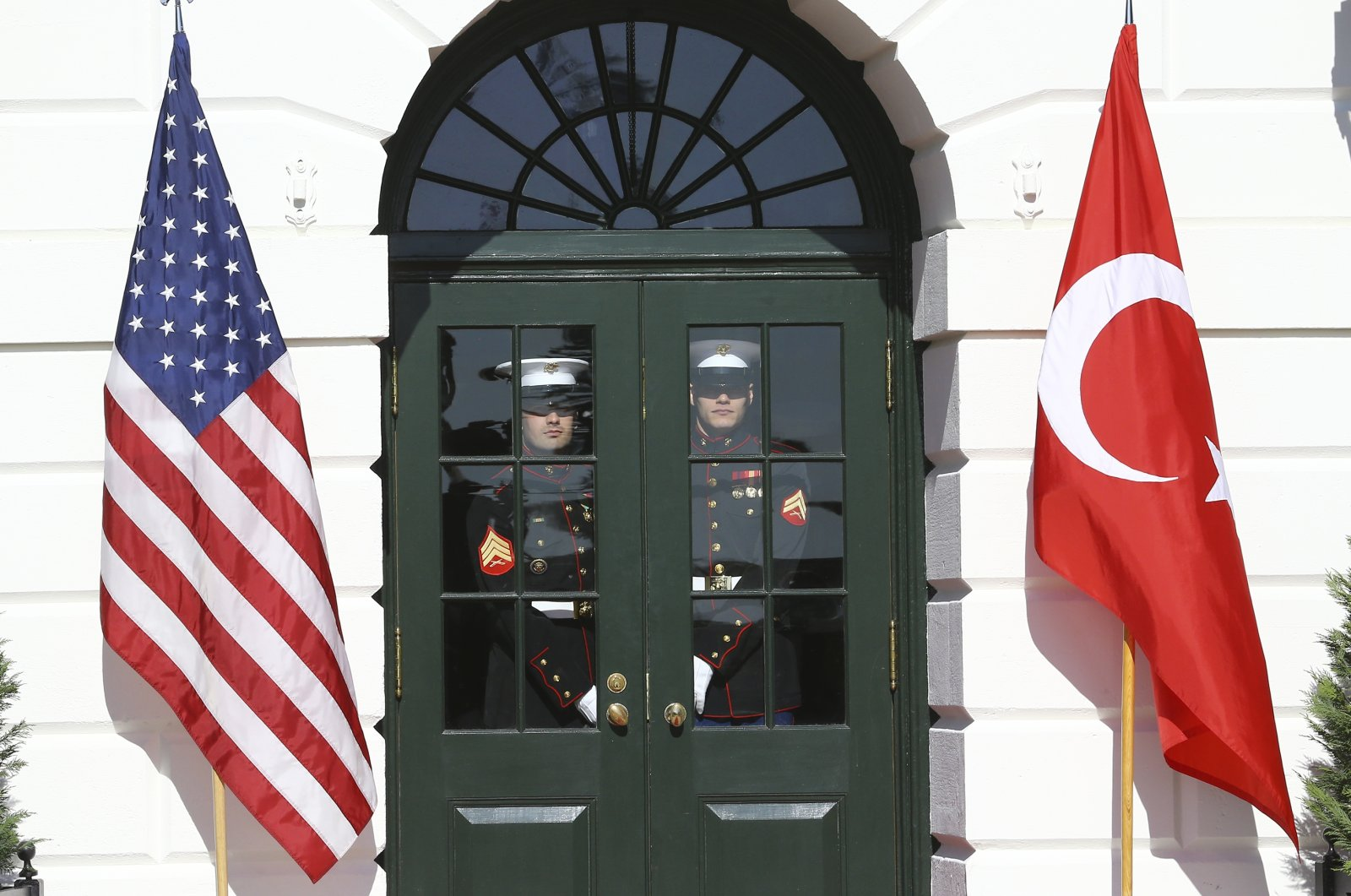 Two U.S. officers stand behind a closed door as part of preparations for the meeting between President Recep Tayyip Erdoğan and U.S. President Donald Trump at the White House, Washington, D.C., Nov. 13, 2019. (AA Photo)