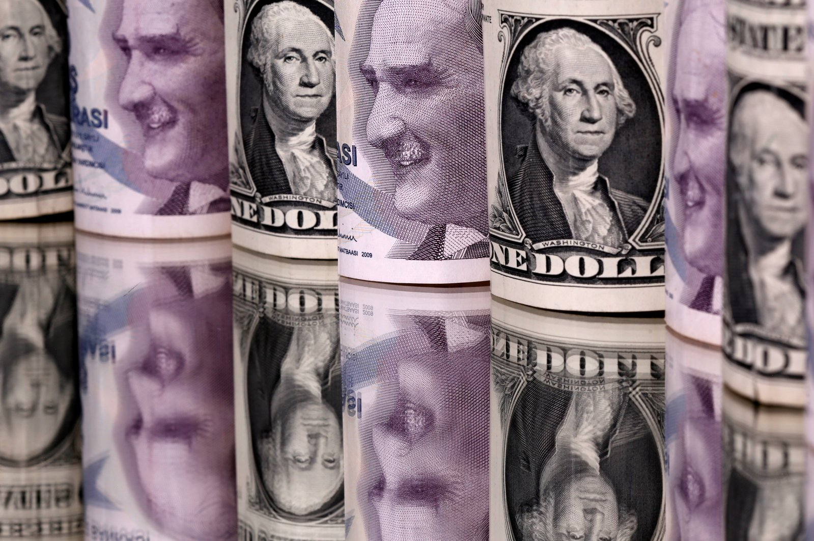 Turkish lira and U.S. dollar banknotes are seen in this illustration created on Jan. 6, 2020. (Reuters Photo)