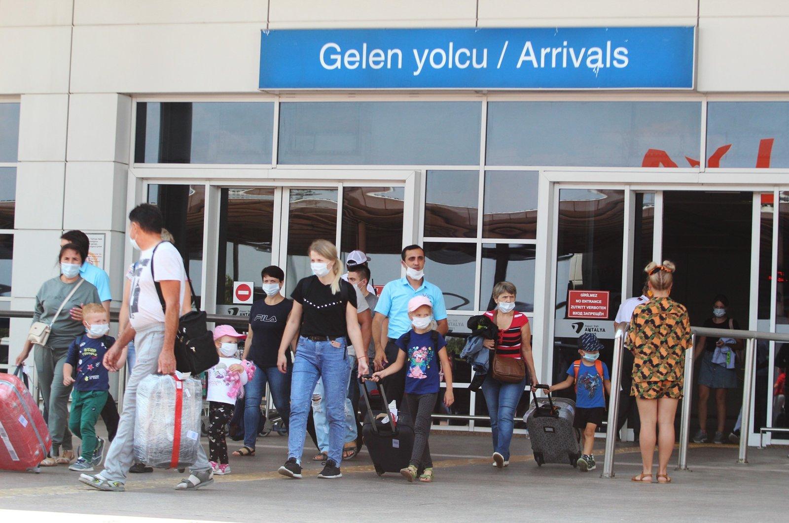 Tourists arrive in Antalya airport, Aug. 20, 2020. (IHA Photo)