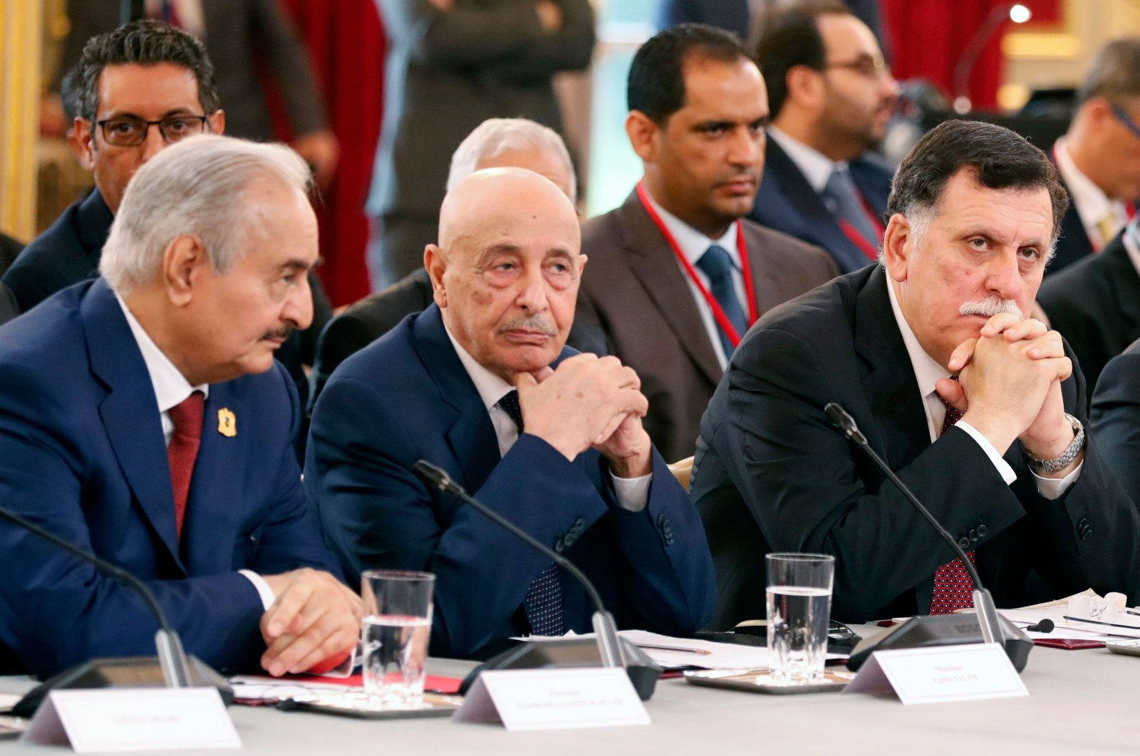Putschist Gen. Khalifa Haftar (L),  speaker of the self-declared eastern-based parliament Aguila Saleh Issa (C), and head of the UN-recognised Government of National Accord (GNA) Fayez Sarraj, attend an International Congress on Libya at the Elysee Palace in Paris, May 29, 2018. (AFP)