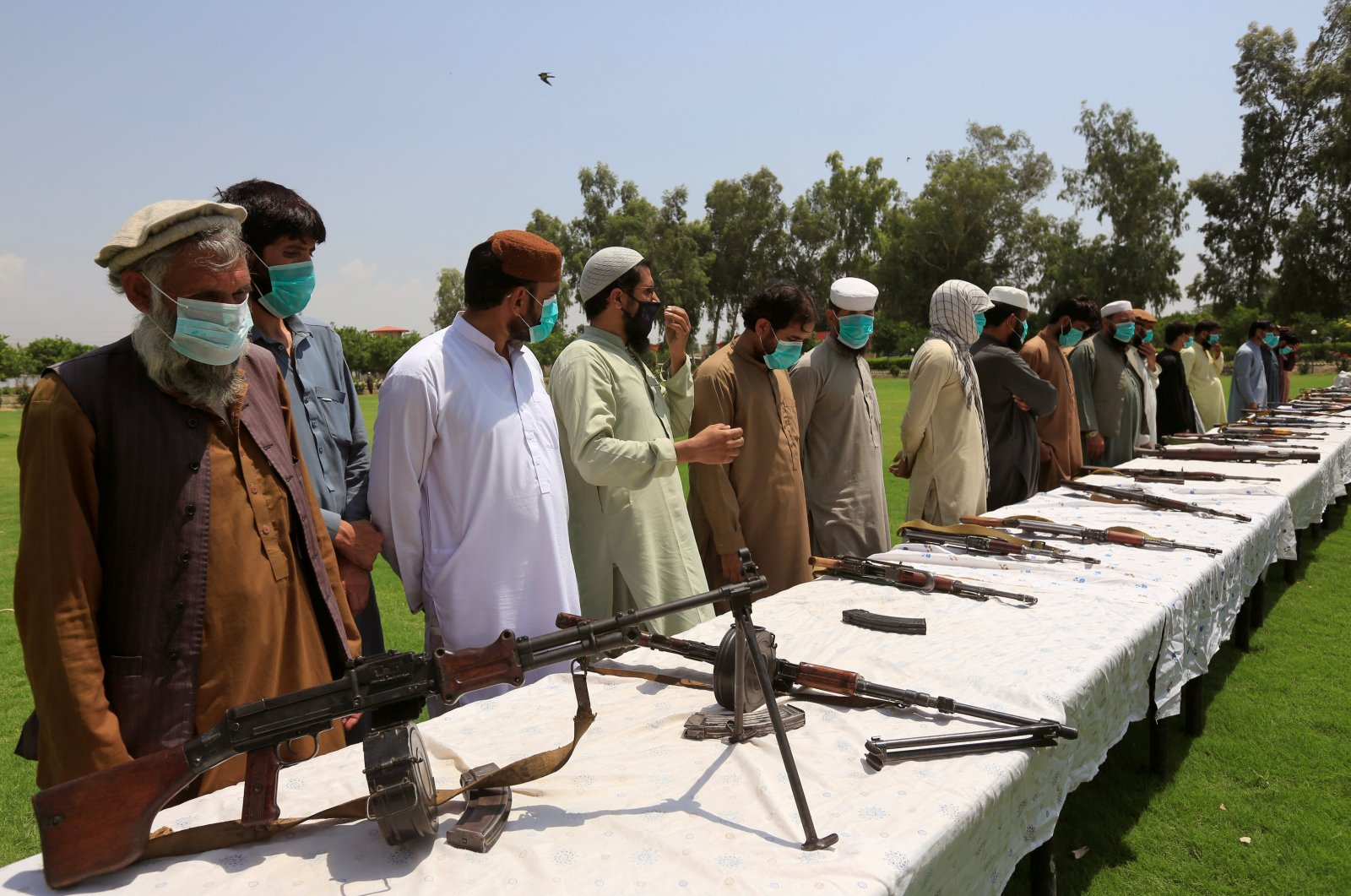 Members of the Taliban handover their weapons and join the Afghan government's reconciliation and reintegration program in Jalalabad, Afghanistan, June 25, 2020. (Reuters Photo)