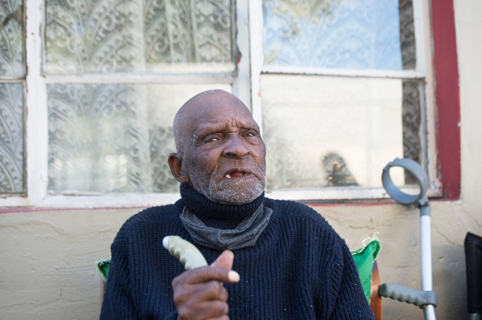 Fredie Blom talks about his recollections as he celebrates his 116th birthday at his home in Delft, near Cape Town on May 8, 2020. (AFP Photo)