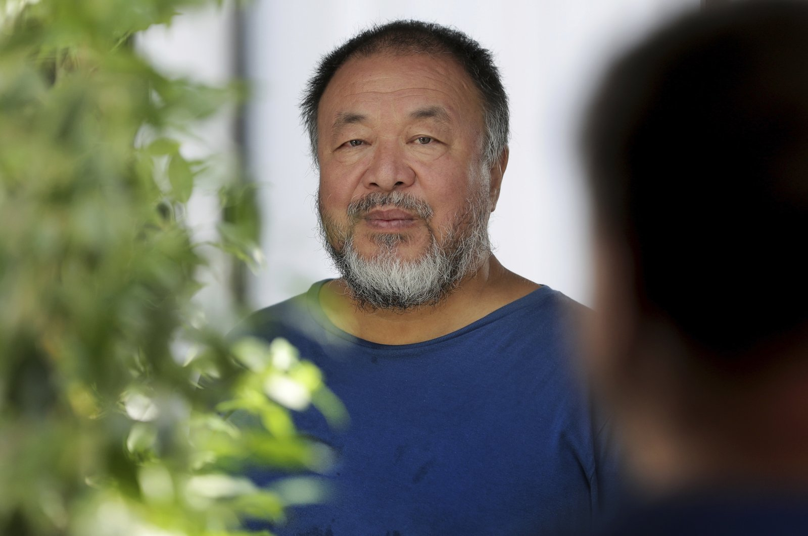 Chinese artist Ai Weiwei poses in front of a mirror for a photo after an interview with The Associated Press in Berlin, Germany, Monday, Aug. 12, 2019 (AP Photo)