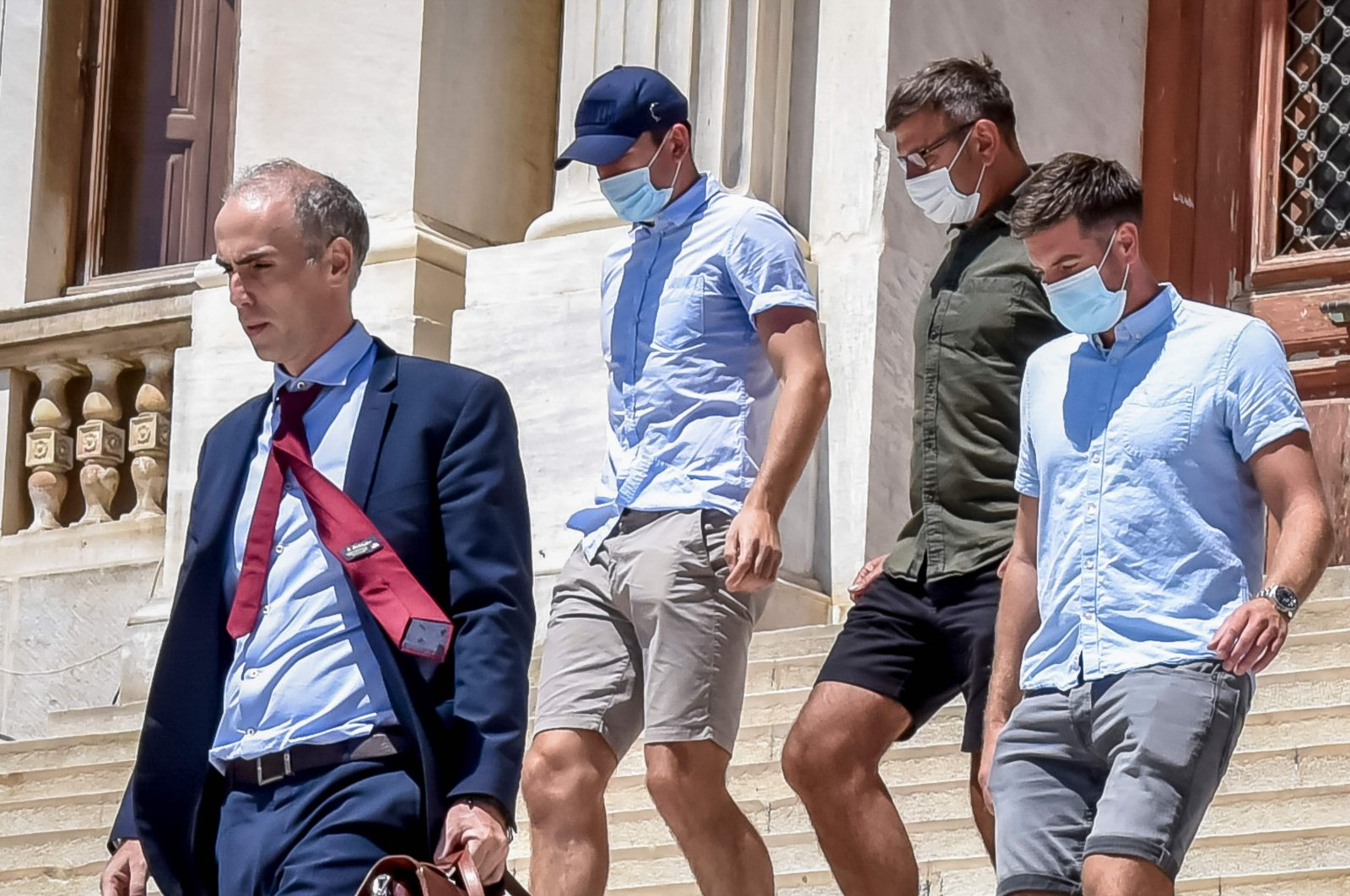 Manchester United football team captain Harry Maguire (2nd L) leaves a courthouse on the Greek island of Syros, the administrative hub of the Cycladic island group that includes Mykonos on August 22, 2020.(AFP Photo)