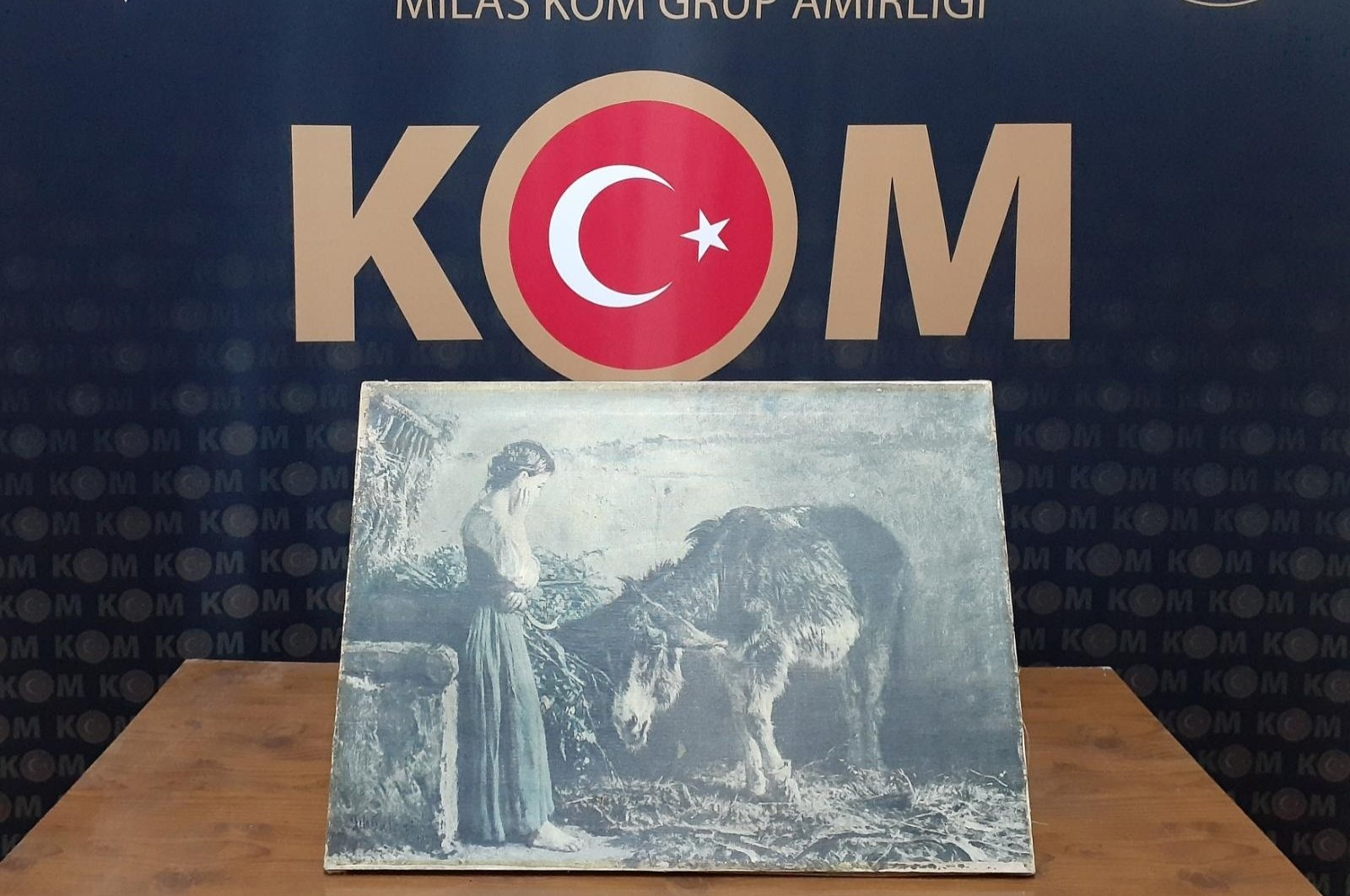 The seized painting allegedly signed by world-famous Italian artist Filippo Palizzi being displayed by the police department in southwestern Muğla, Turkey on August 22 2020. (AA Photo)