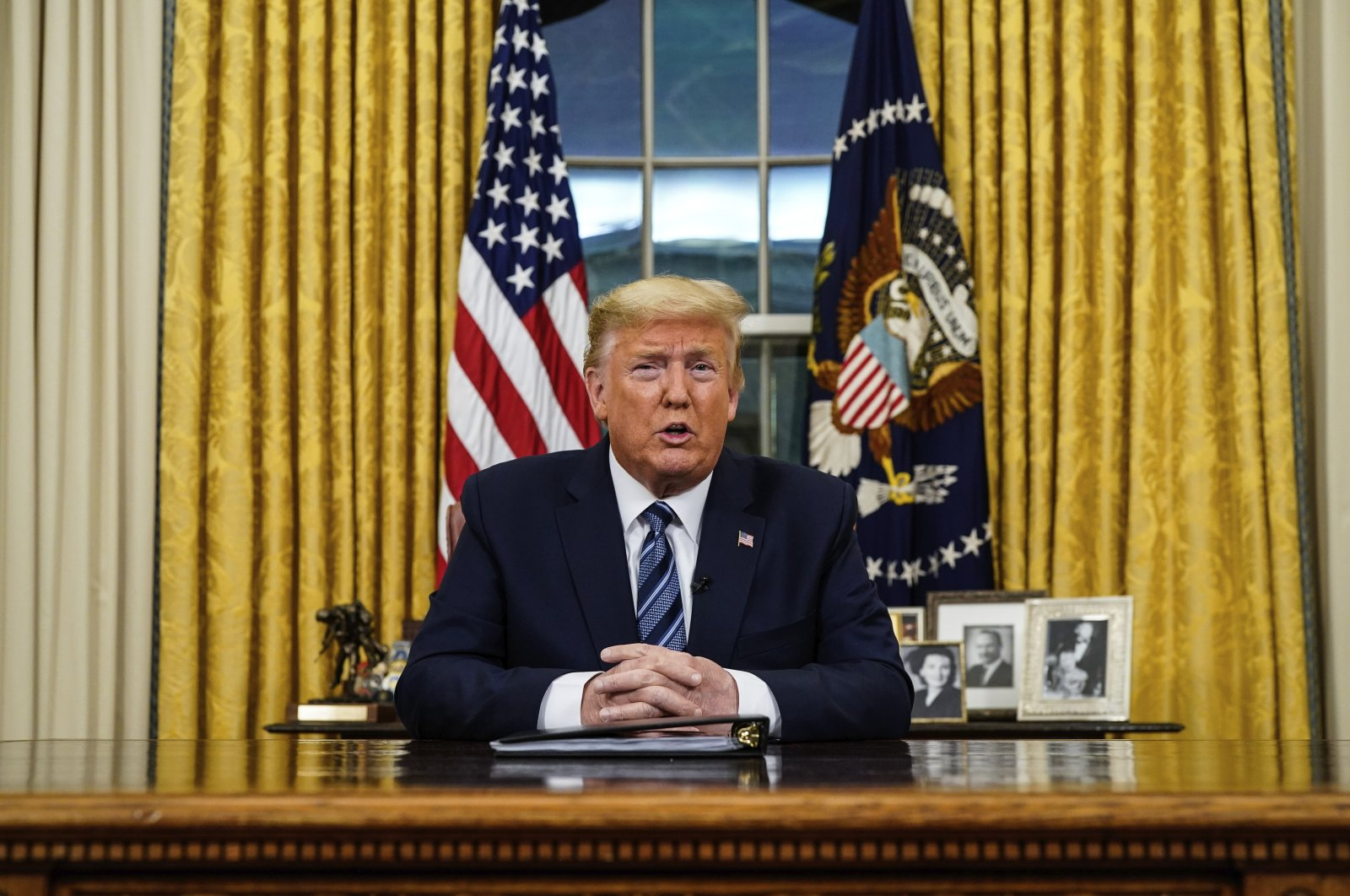 In this March 11, 2020, file photo President Donald Trump speaks in an address to the nation from the Oval Office at the White House about the coronavirus in Washington. (AP Photo)