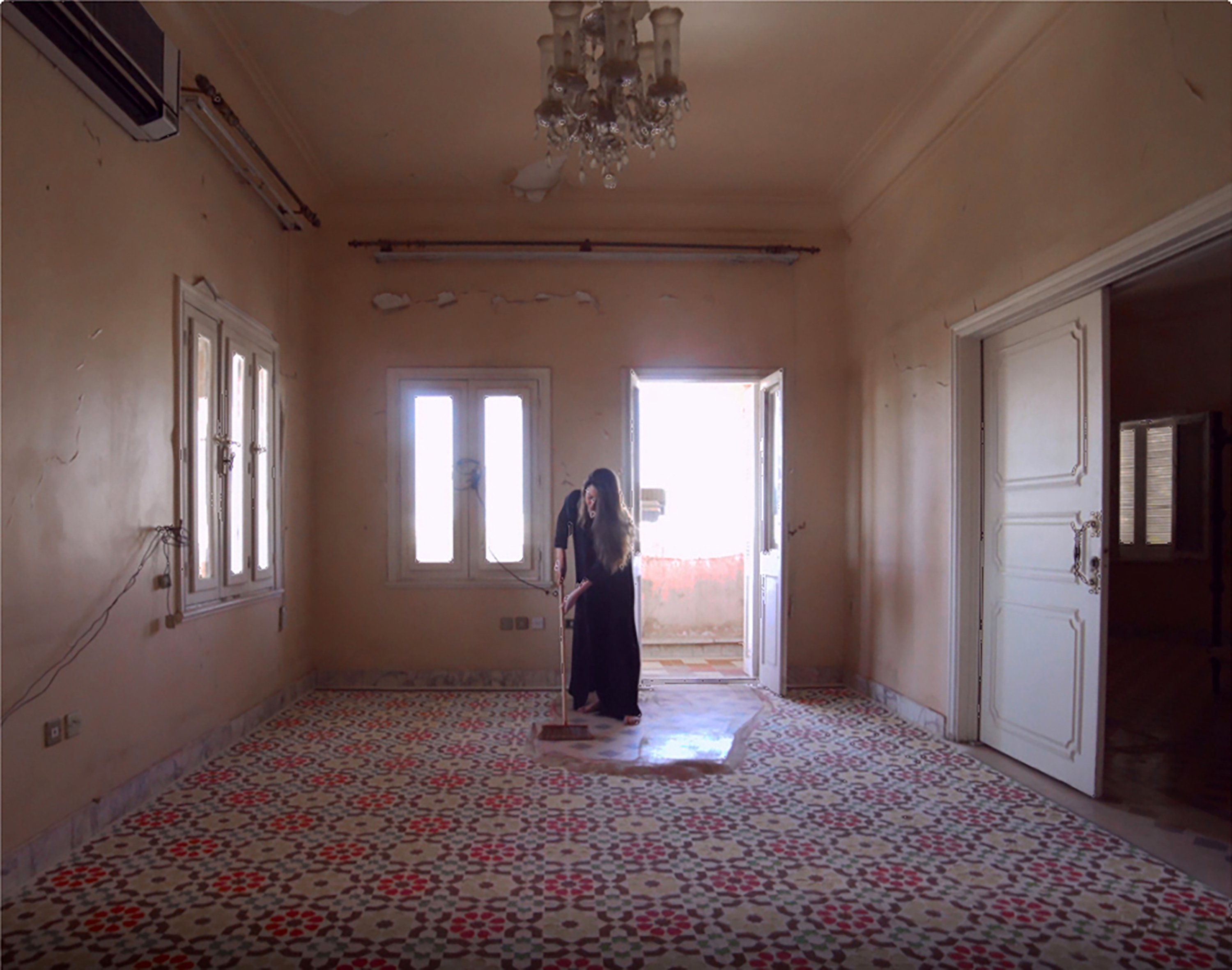 Dana Awartani, 'I Went Away and Forgot You. A While Ago I Remembered. I Remembered I'd Forgotten You. I Was Dreaming,' mixed media installation with sand and natural pigment, single-channel video, 22'11''. (PHOTO COURTESY OF PERA MUSEUM)