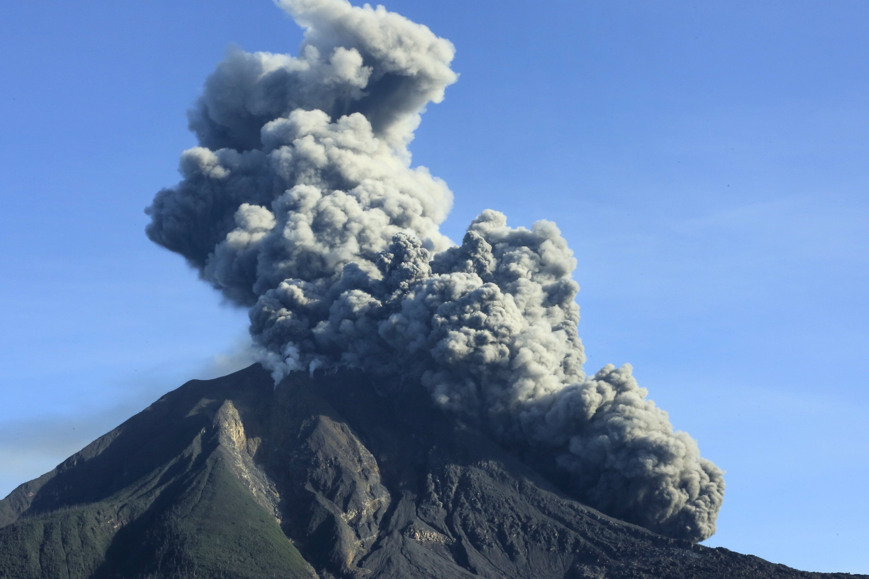 Mount Sinabung spews volcanic ash into the air during an eruption as seen from Karo, North Sumatra, Indonesia, Aug. 23, 2020. (EPA Photo)