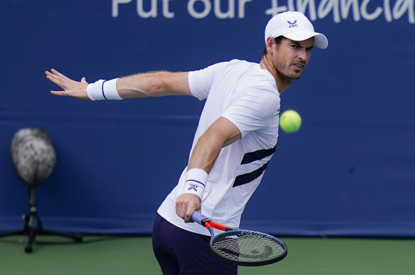 Andy Murray returns to Frances Tiafoe at the Western & Southern Open tennis tournament, in New York, U.S., Aug. 22, 2020. (AP Photo)