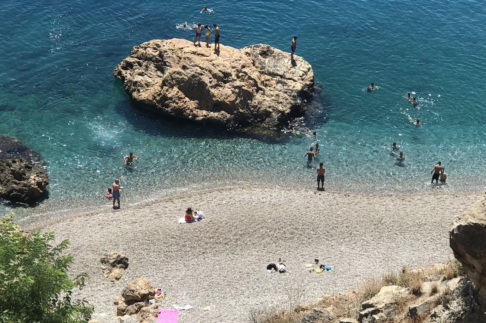 People enjoy the sea at Konyalaltı Beach in Antalya, Turkey, Aug. 16, 2020. (AA Photo)