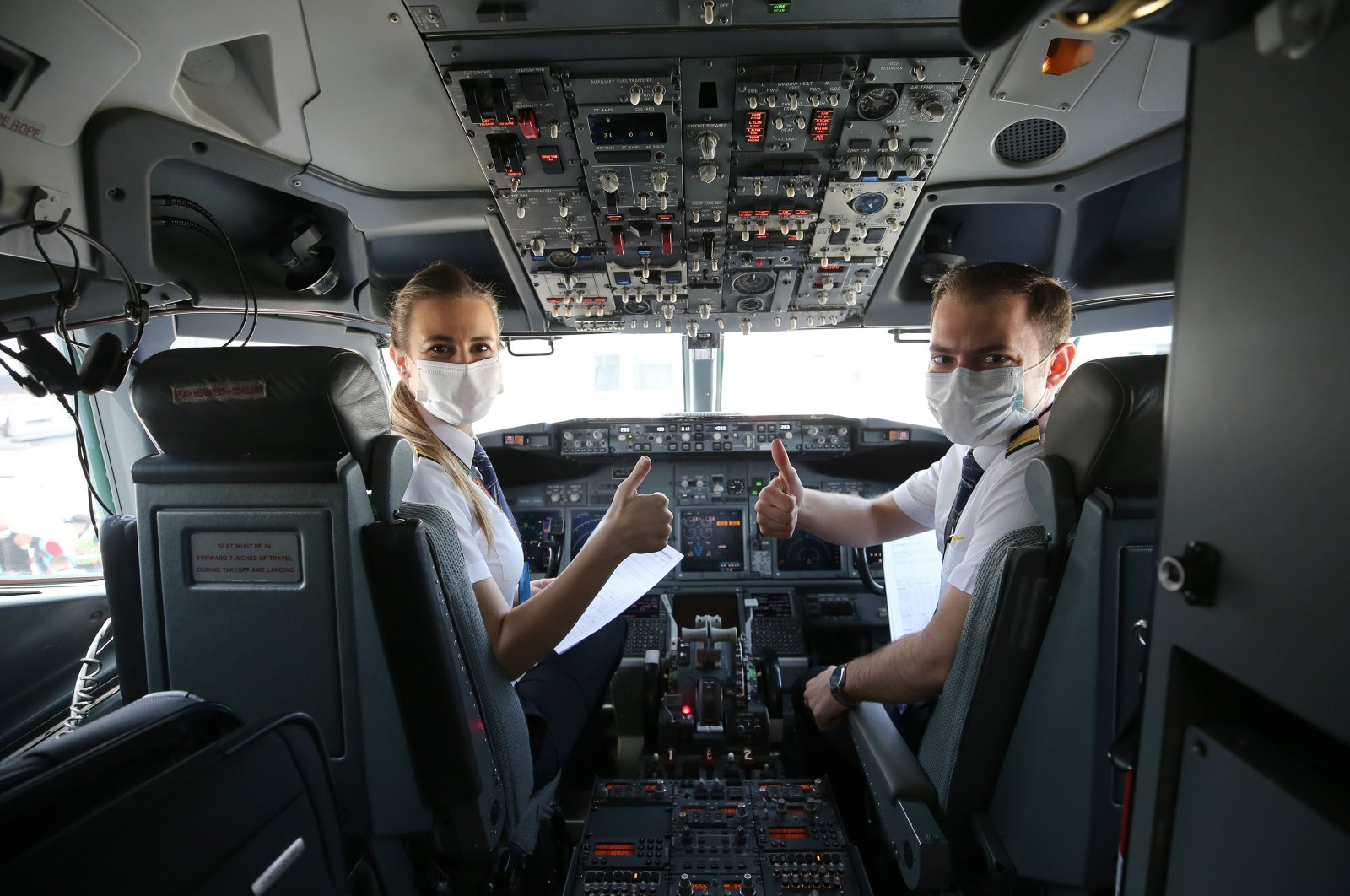 Turkish Airlines pilots Selin Demirli (L) and Zafer Doğukan conduct a special flight from Istanbul to the Black Sea province of Samsun to commemorate the start of the Turkish national struggle 101 years ago, May 19, 2020. (AA Photo)