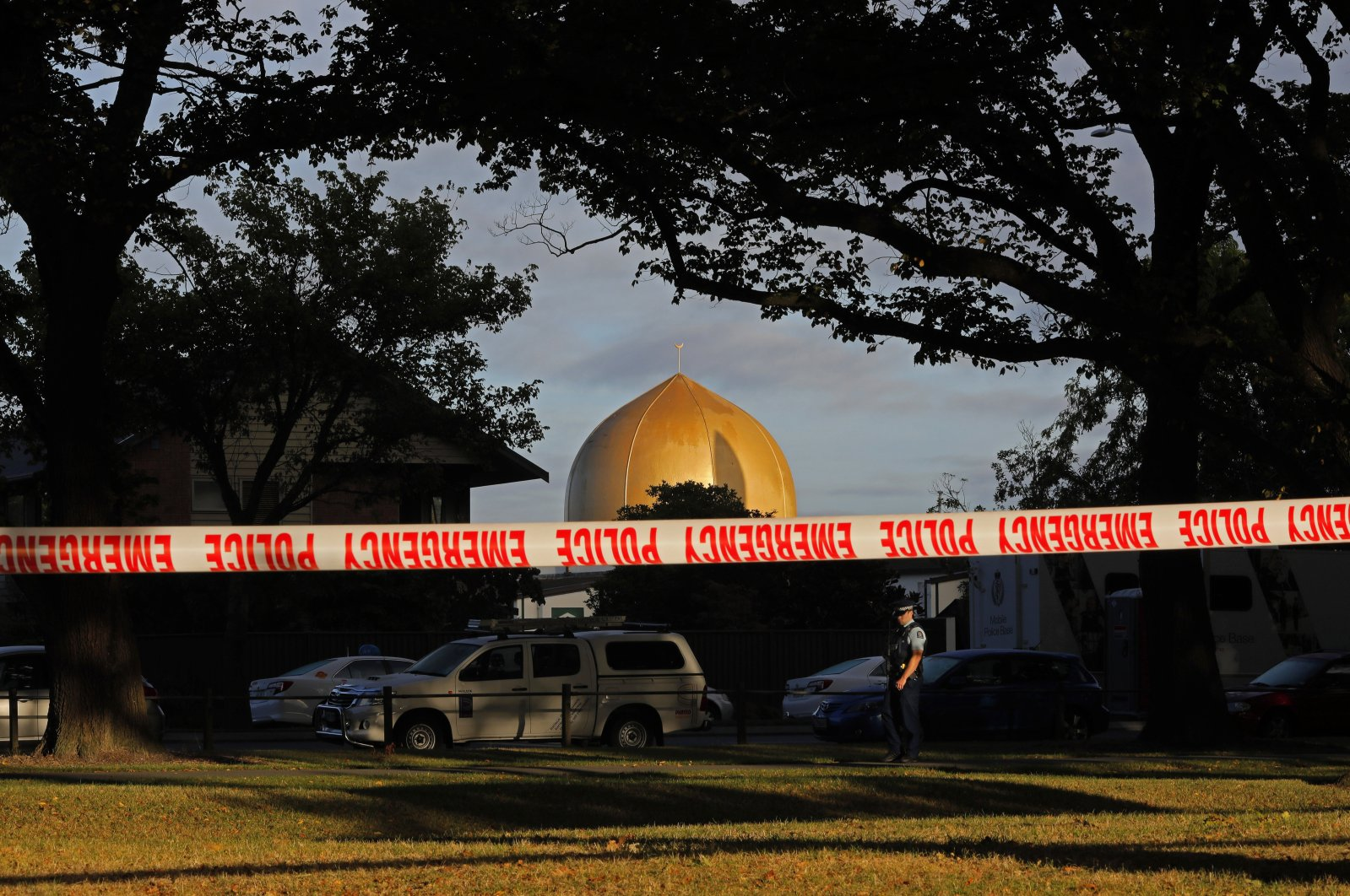 In this March 17, 2019, file photo, a police officer stands guard in front of the Masjid Al Noor mosque in Christchurch, New Zealand, where one of two mass shootings occurred. (AP Photo)