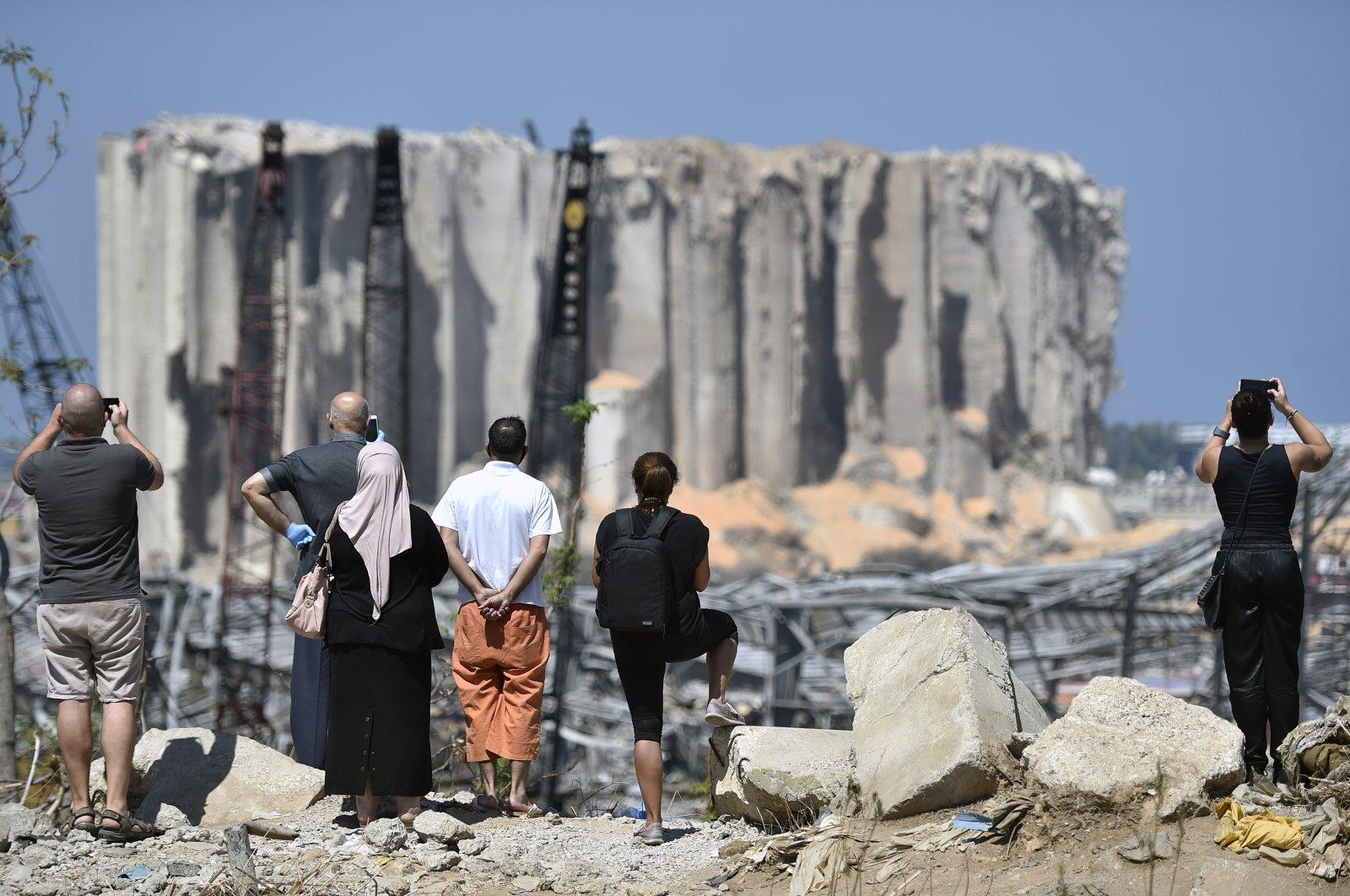 Lebanese people take pictures of damaged grain silos in Beirut port following a huge explosion rocked the city in Beirut, Lebanon, Aug. 23, 2020. (EPA Photo)
