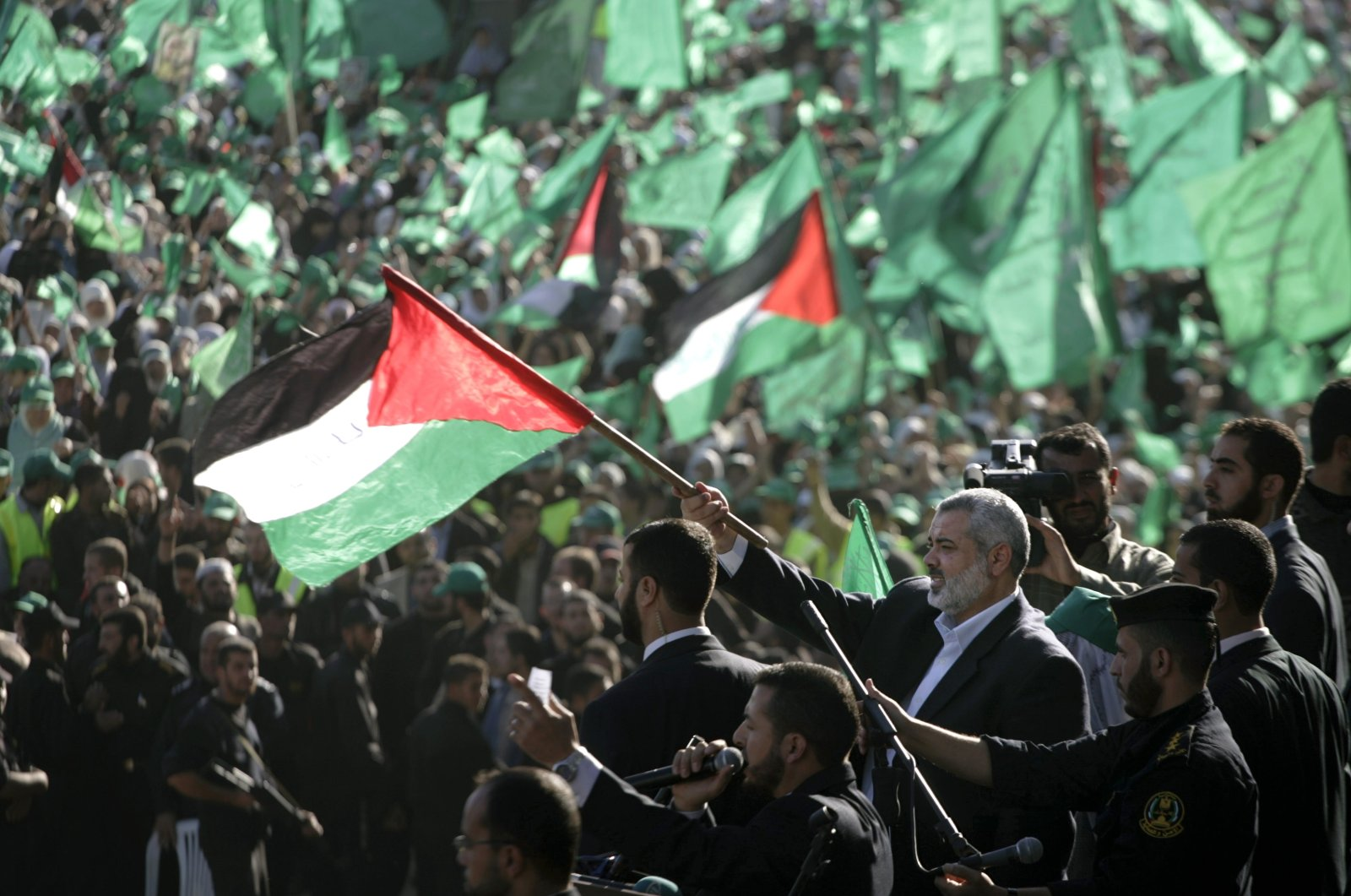Chief of Hamas political bureau Ismail Haniyeh waves a Palestinian flag during a celebration of the 20th anniversary of the foundation of Hamas in this undated photo. (AP Photo)