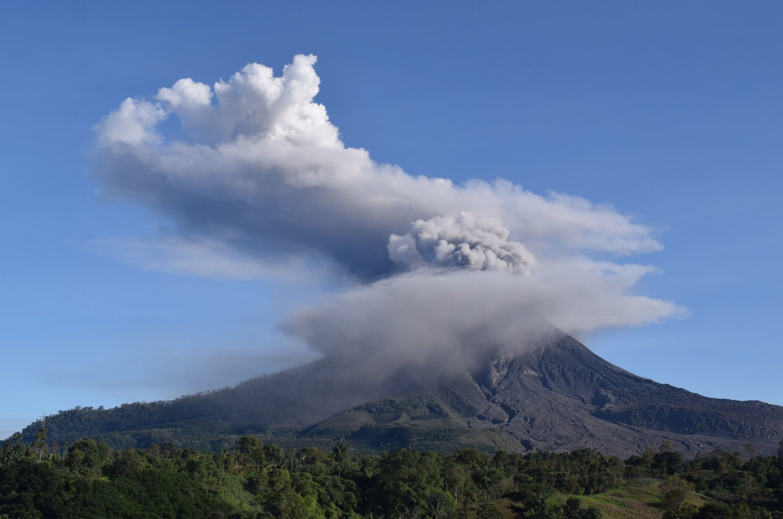 Mount Sinabung spews thick smoke into the air in Karo, North Sumatra, Indonesia, Aug. 23, 2020. (AFP Photo)