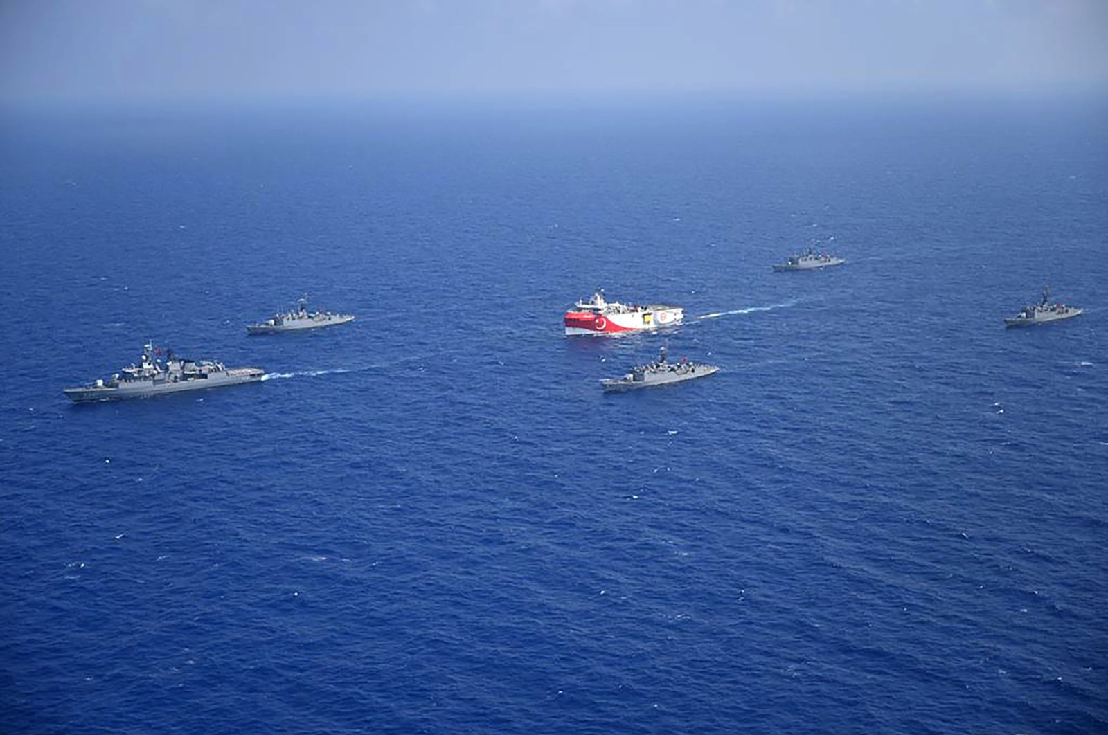 Turkish seismic research vessel Oruç Reis (C) is escorted by Turkish naval ships in the Mediterranean Sea, off Turkey's southern Antalya province, Aug. 12, 2020. (Turkish Defense Ministry handout via AFP Photo)