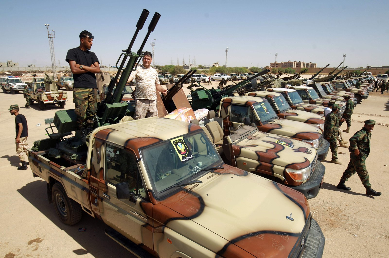 Members of putschist Gen. Khalifa Haftar's forces gather on their way to reportedly back up fellow fighters on the front line west of the city of Sirte facing off against the military loyal to the Government of National Accord (GNA), Benghazi, Libya, June 18, 2020. (AFP Photo)