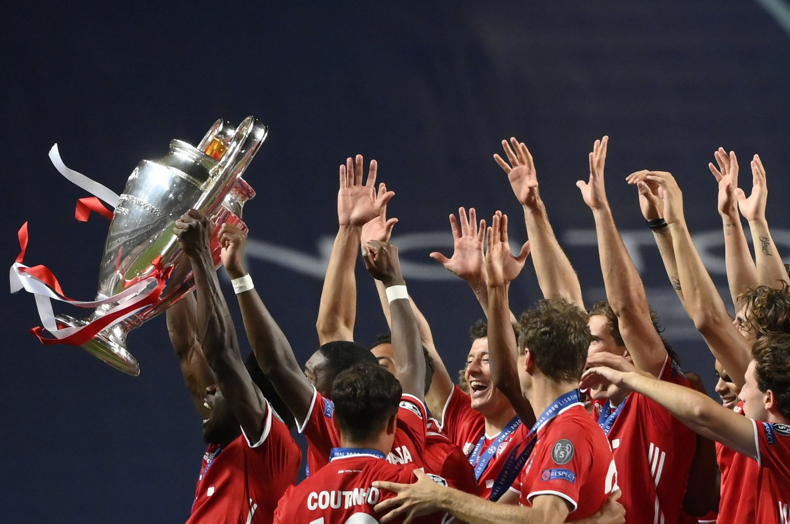 Bayern Munich players players celebrate with the trophy after winning the Champions League in Lisbon, Portugal, Aug. 23, 2020. (AP Photo)