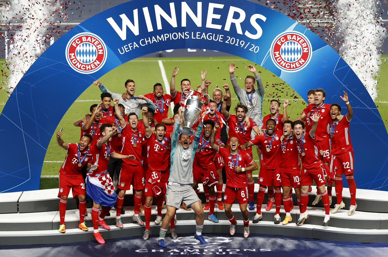 Bayern Munich's Manuel Neuer lifts the trophy with his teammates after winning the Champions League final match against Paris Saint-Germain in Lisbon, Portugal, Aug. 23, 2020. (AP Photo)