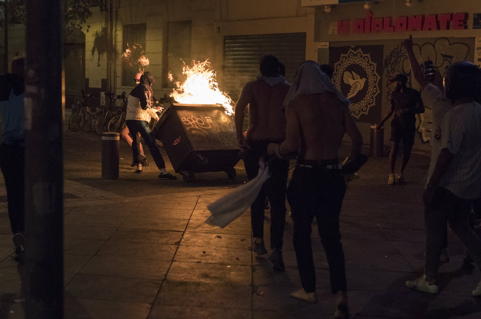 Fans hurl a burning container at police during violent riots reacting to Bayern Munich's victory in a Champions League final soccer match with Paris Saint-Germain, in Marseille, southern France, Aug. 23, 2020. (AP Photo)