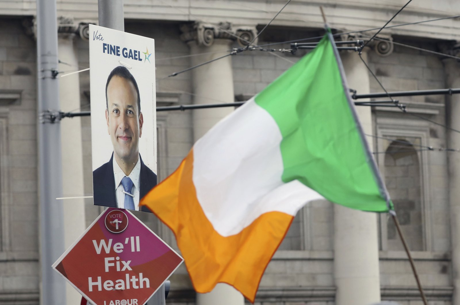 Election posters are displayed on lampposts in Dublin, Ireland, Feb. 7, 2020. (AP Photo)